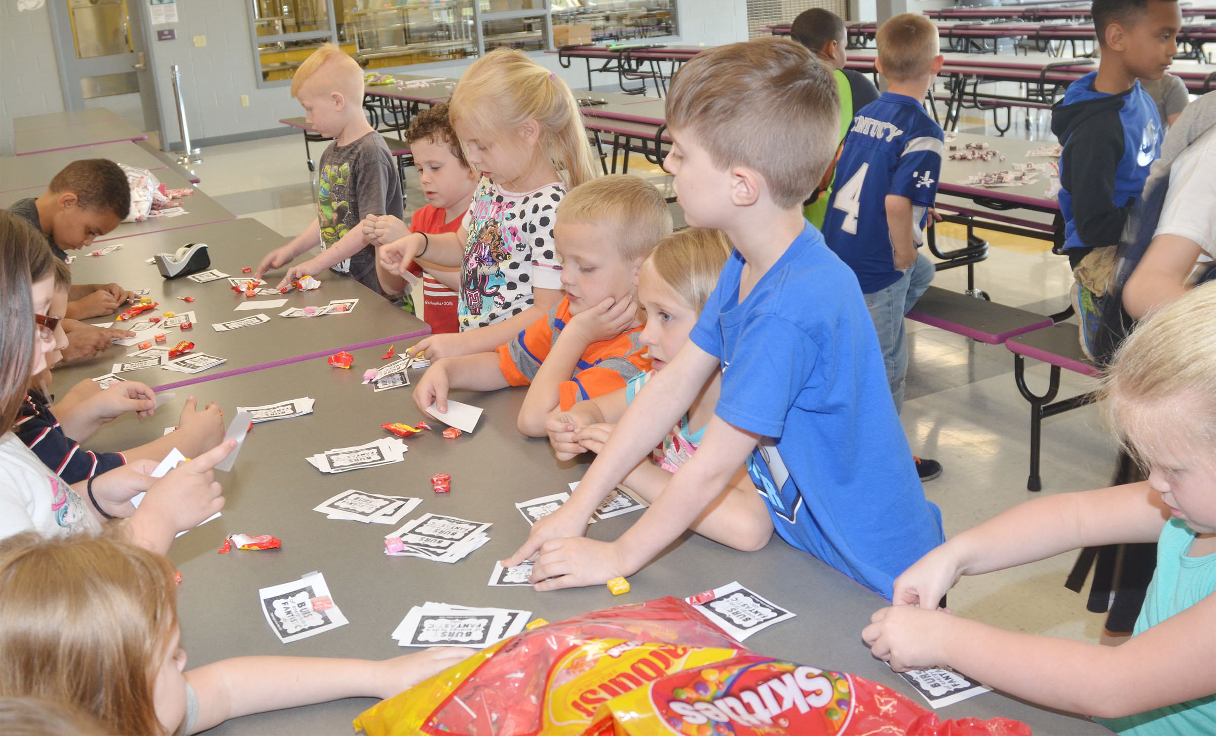 CES kindergarteners sort treats for third-grade students who will soon take state standardized tests.