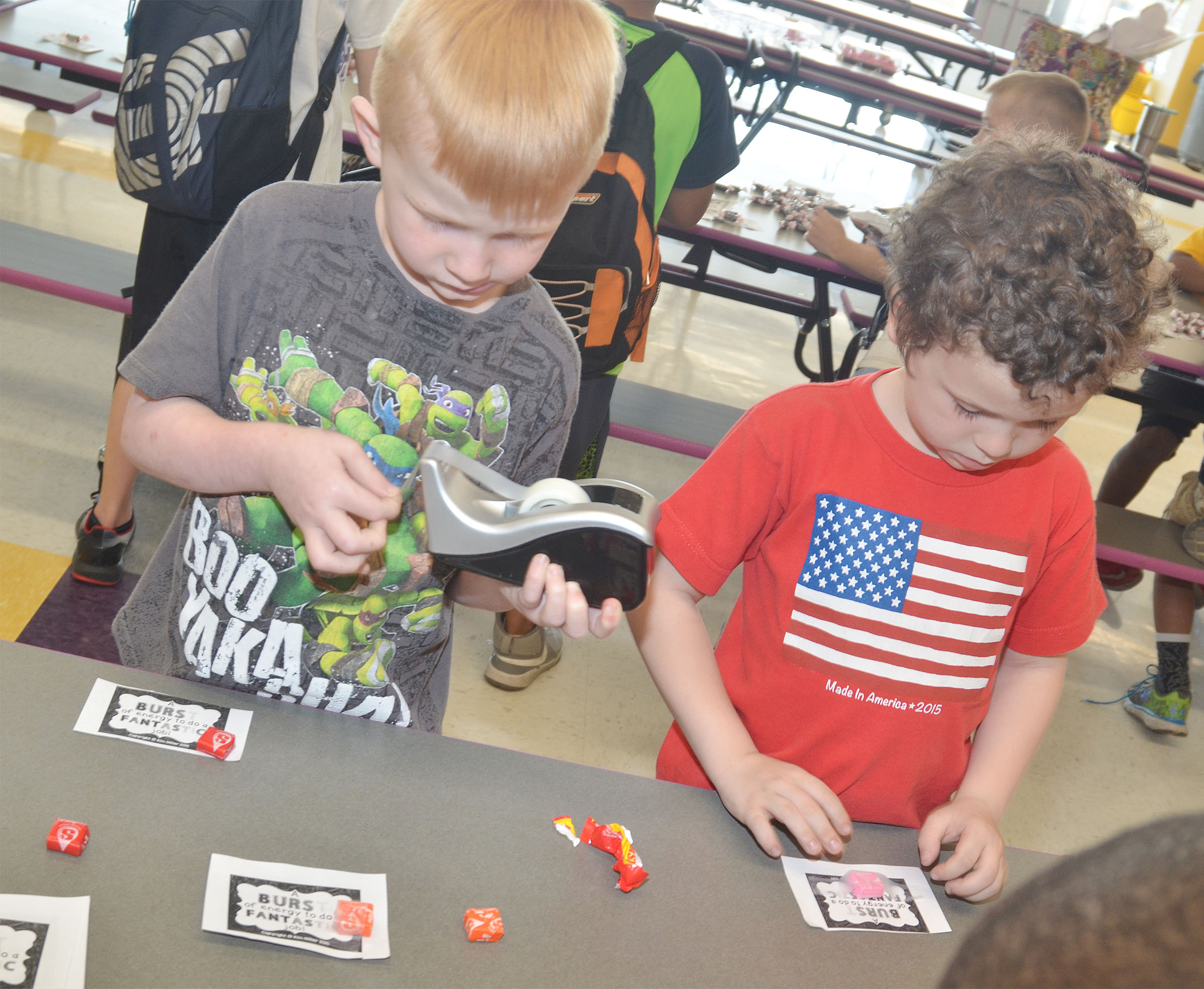 CES kindergarteners Jayden Maupin, at left, and Brayden Perkins sort Starbursts for third-graders.