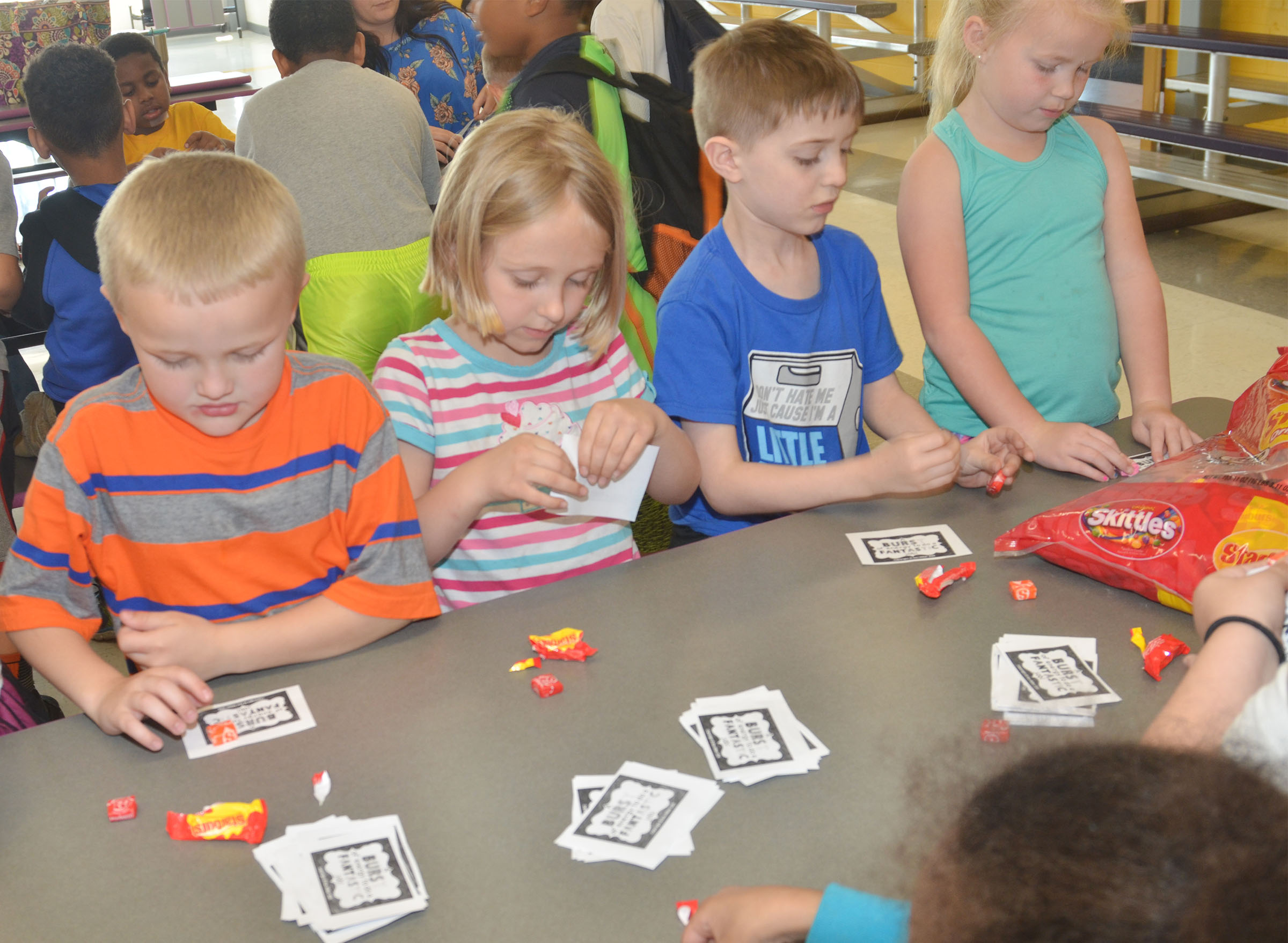 CES kindergarteners, from left, Tristian Harris, LeeAnna Garvin, Caleb Goodson and Lillie Judd sort Starbursts for third-graders.