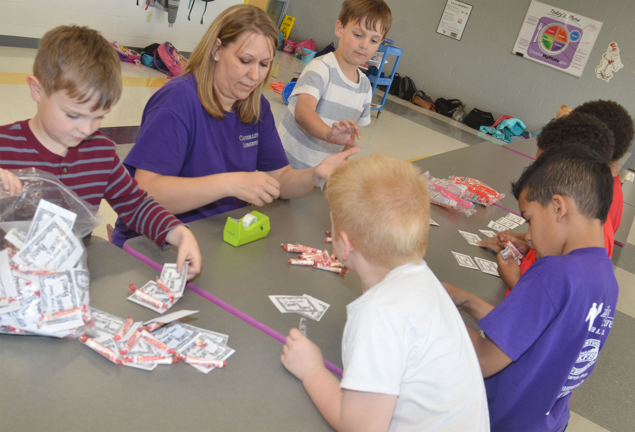 CES first-grade teacher Amanda Greer helps her students sort Smarties for third-graders.