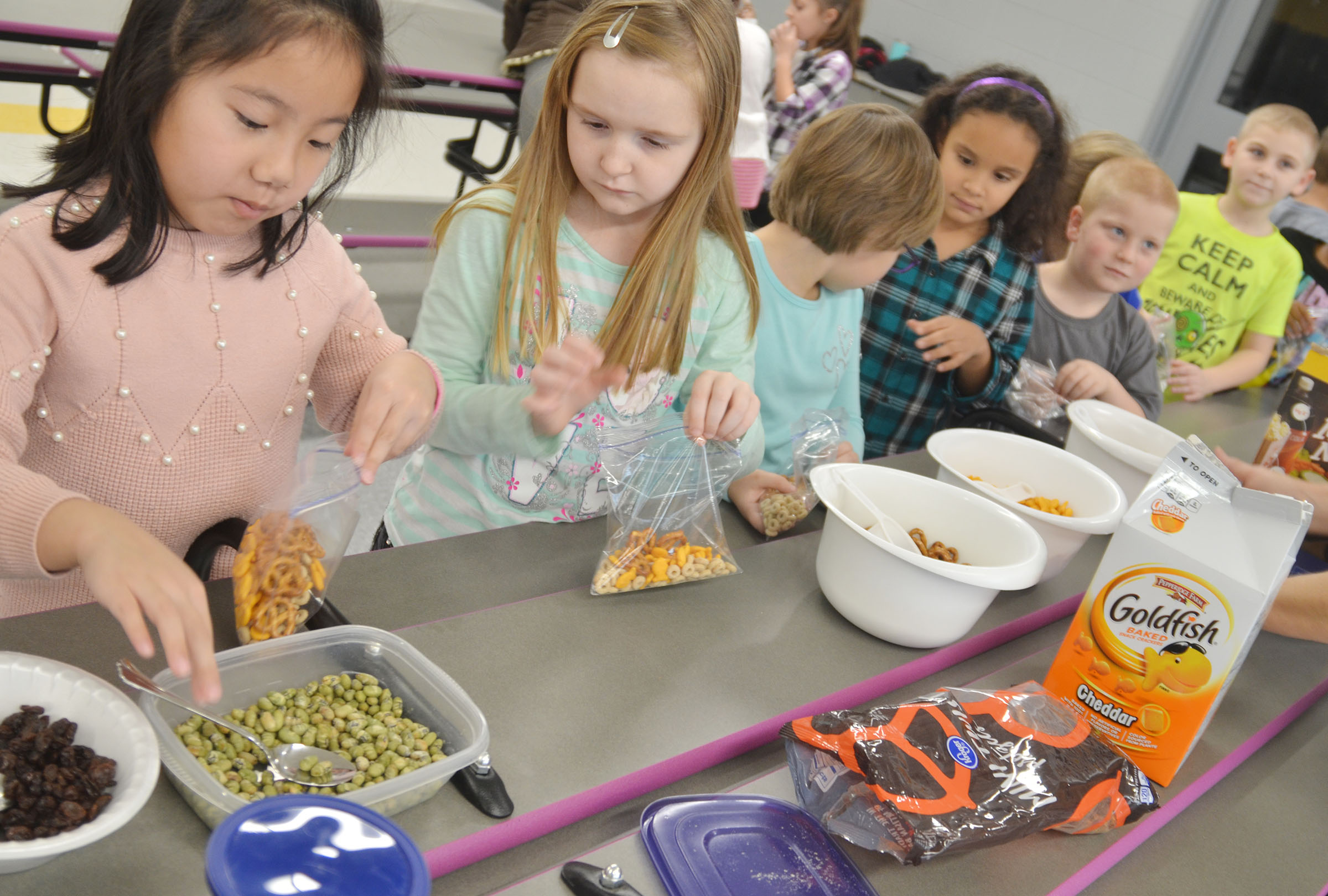 CES first-graders Tina Jiang, at left, and Gracie Murphy sample edamame.