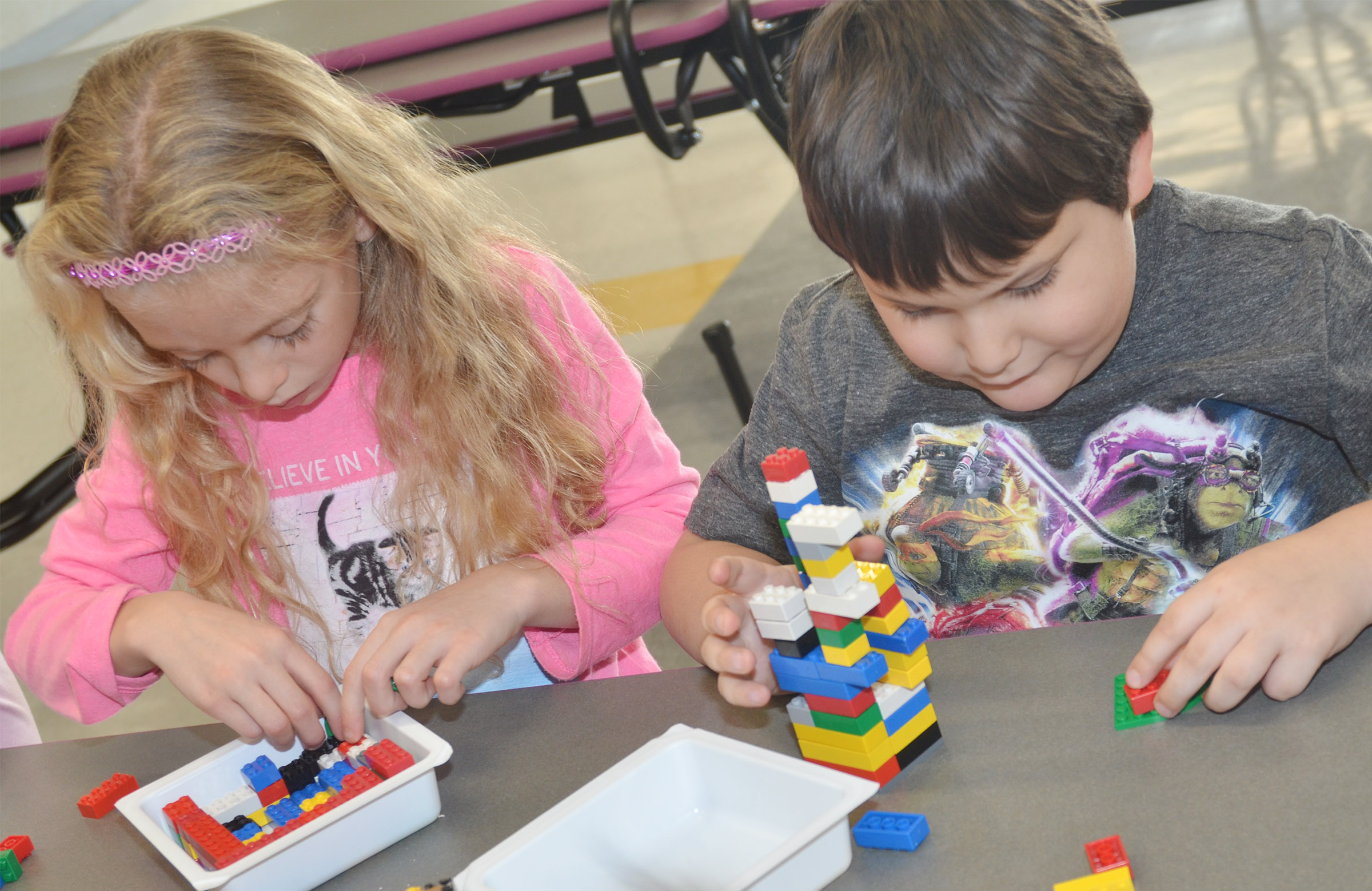 CES kindergarteners Aliyah Litsey, at left, and Cloud Malone build their Lego volcanos.