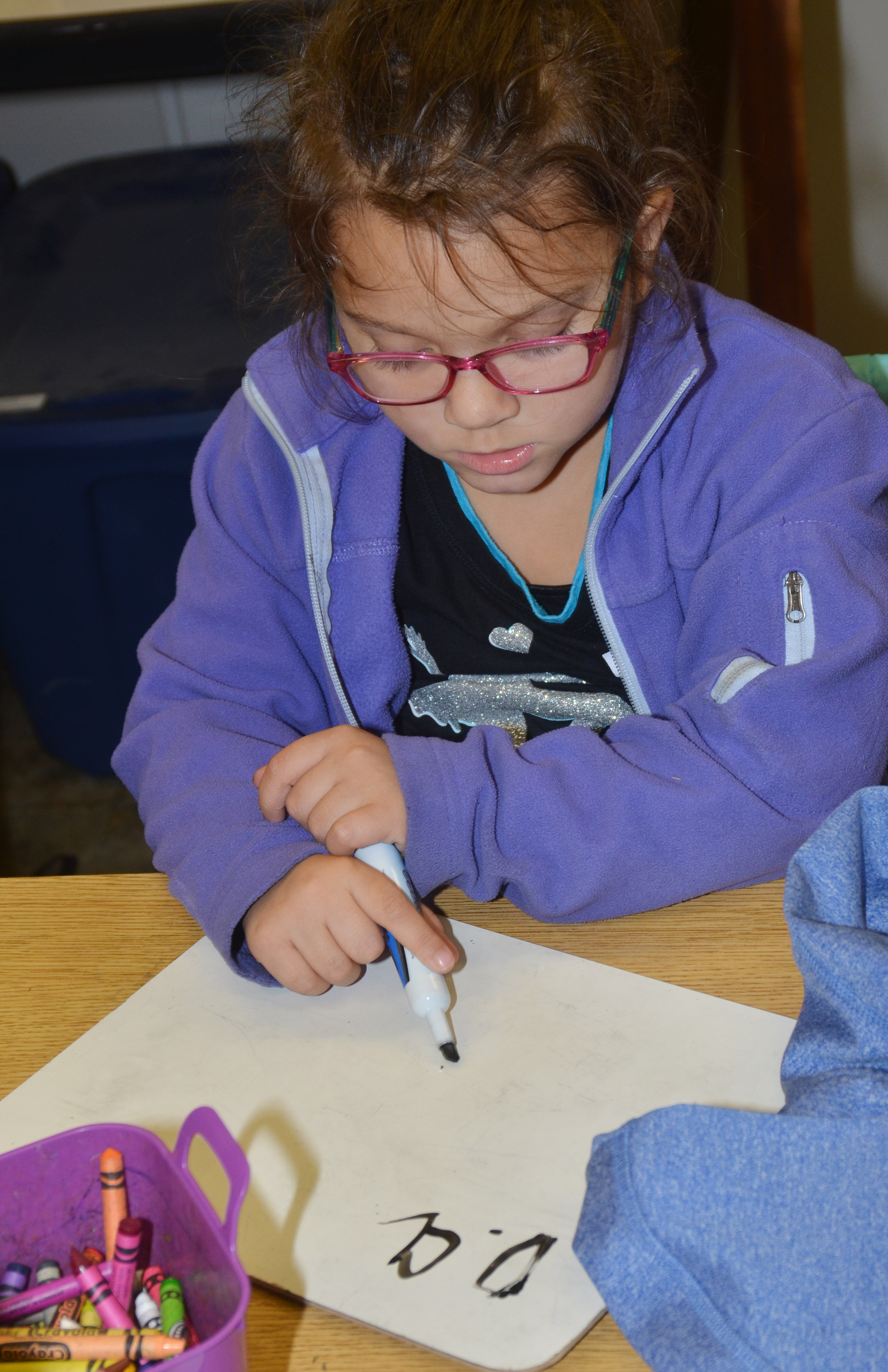 CES kindergartener Addisyn Taylor practices writing letters.
