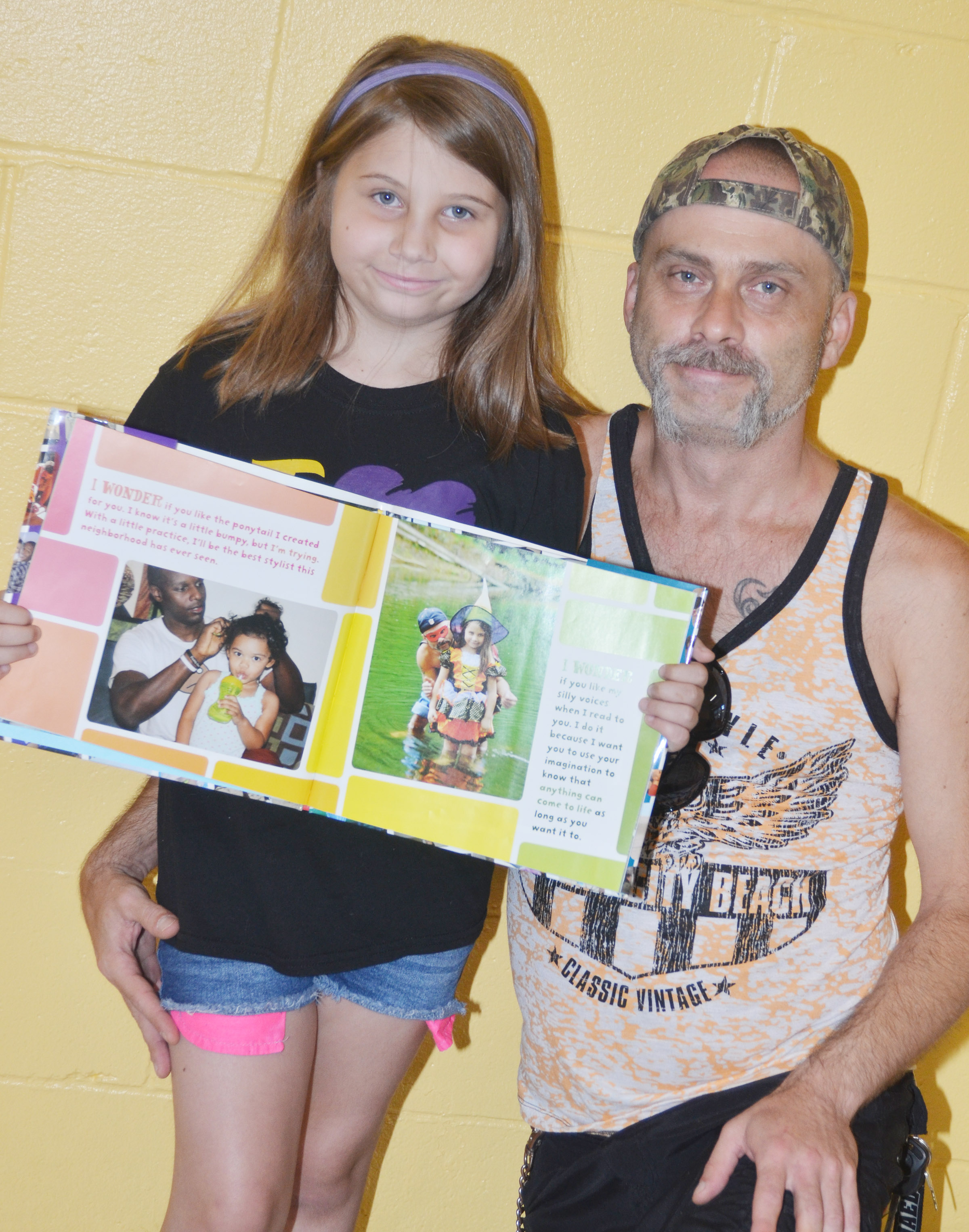 "Campbellsville Elementary School third-grader Natalia West has been featured in a book about children and their fathers. A photo of West and her father, Michael, was chosen from thousands of entries to be included in the book ""I Wonder: Celebrating Daddies Doin' Work"" by Doyin Richards."