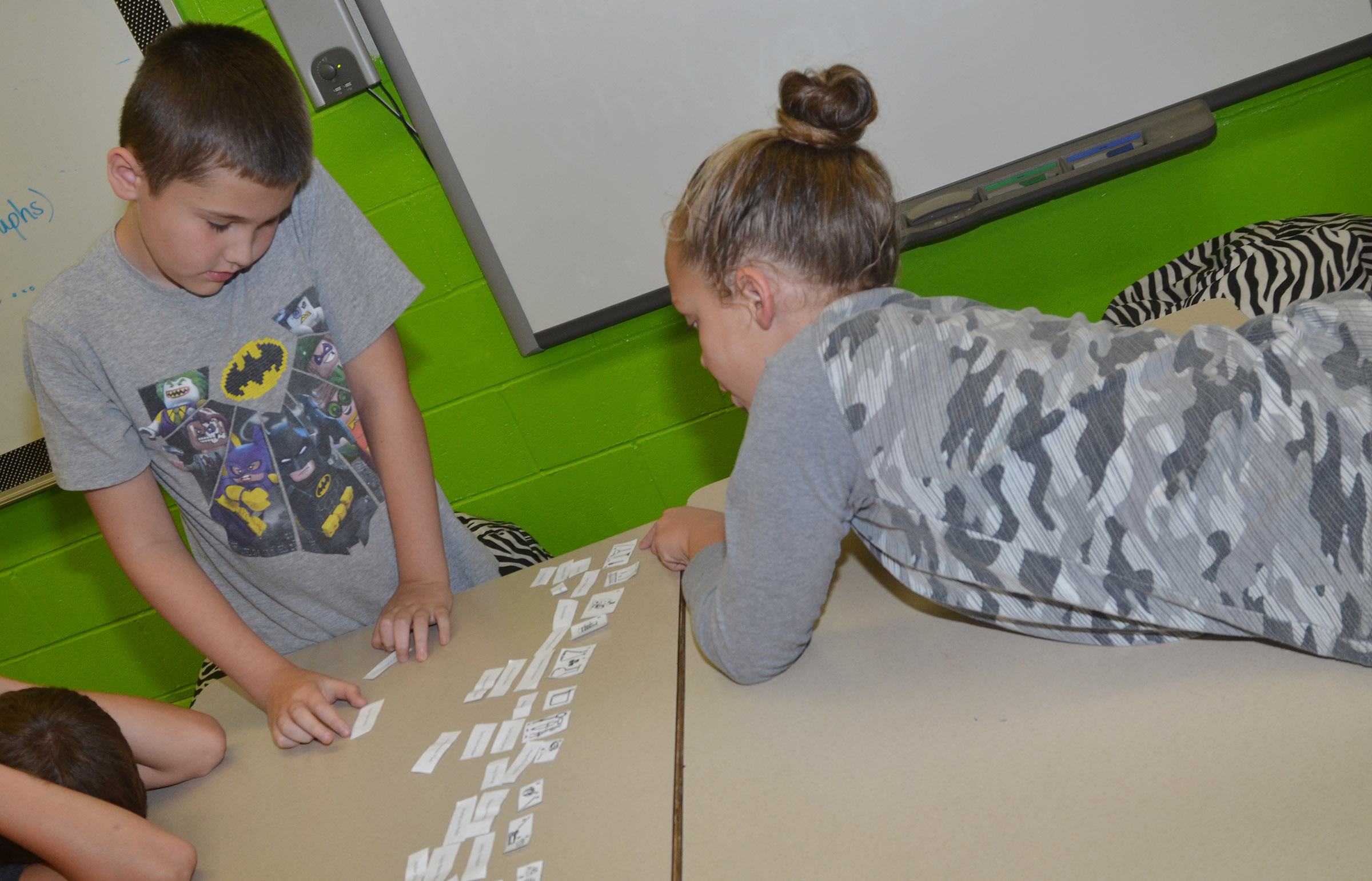 CES fifth-graders Michael Abel, at left, and Deanna Reardon check their scientific terms to see if they are paired with the right pictures.