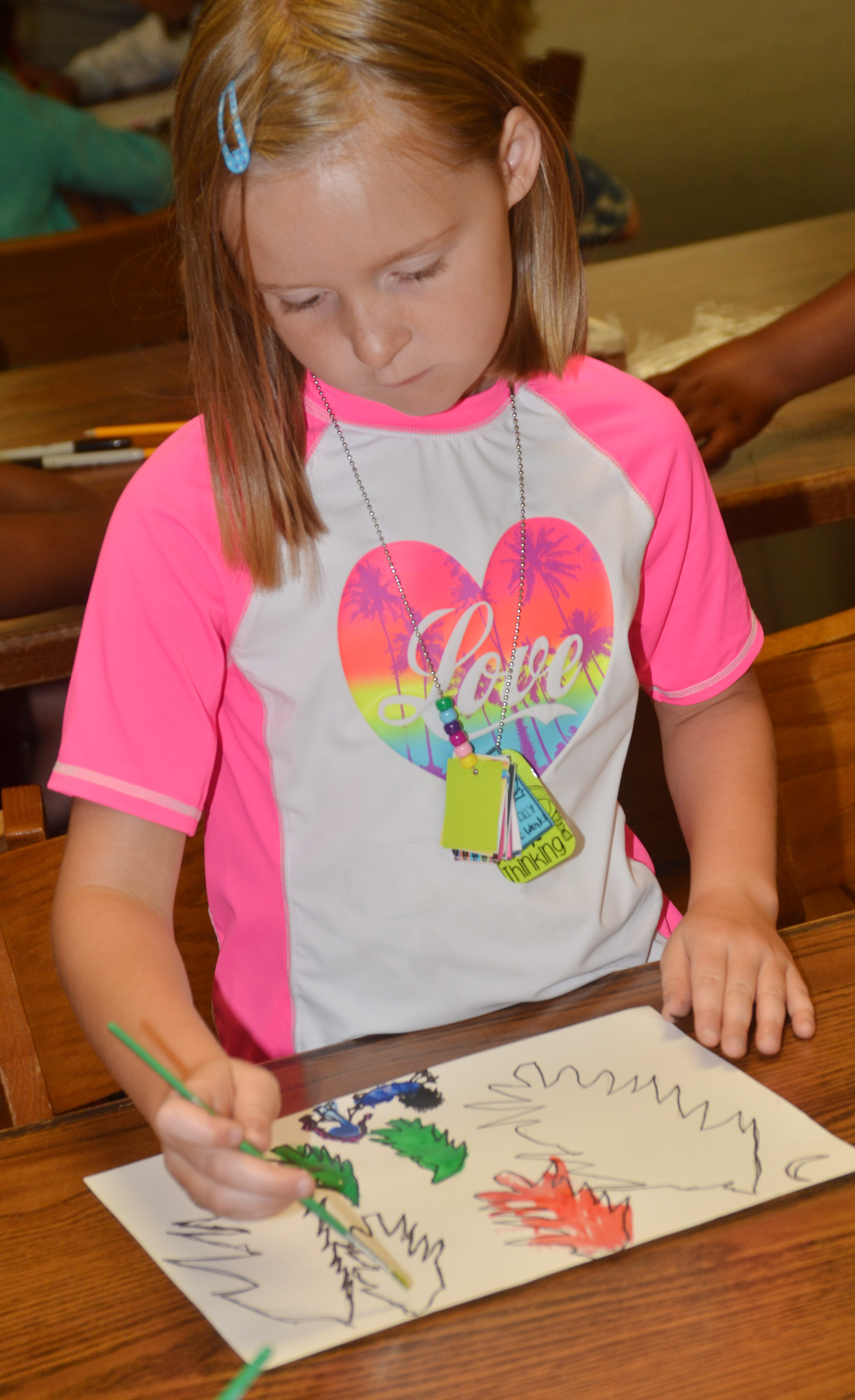 CES first-grader Gracie Murphy paints.