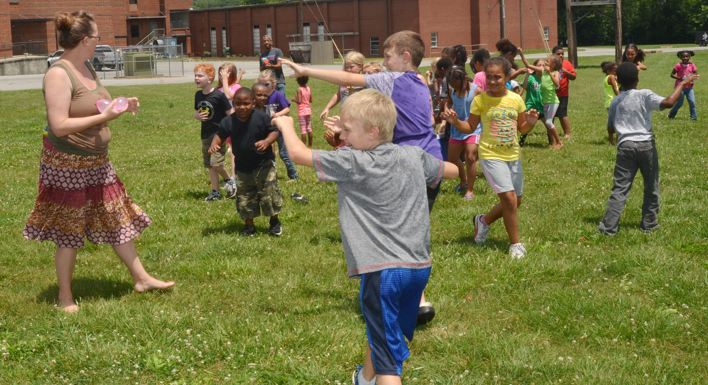 CES Wings Express assistants and students battle in a water fight.