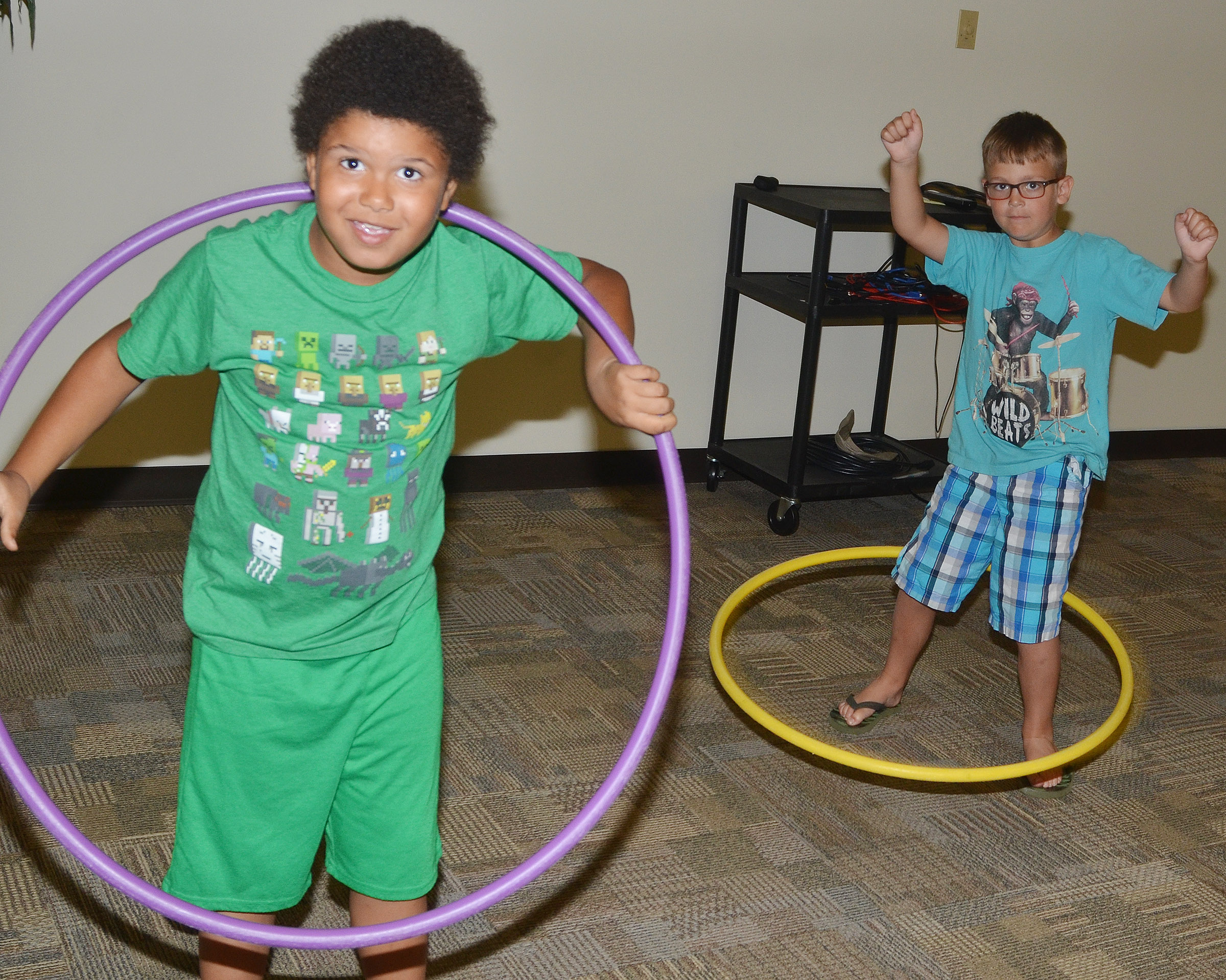 CES first-graders Navon Copeland, at left, and Brendan Martin hula hoop.