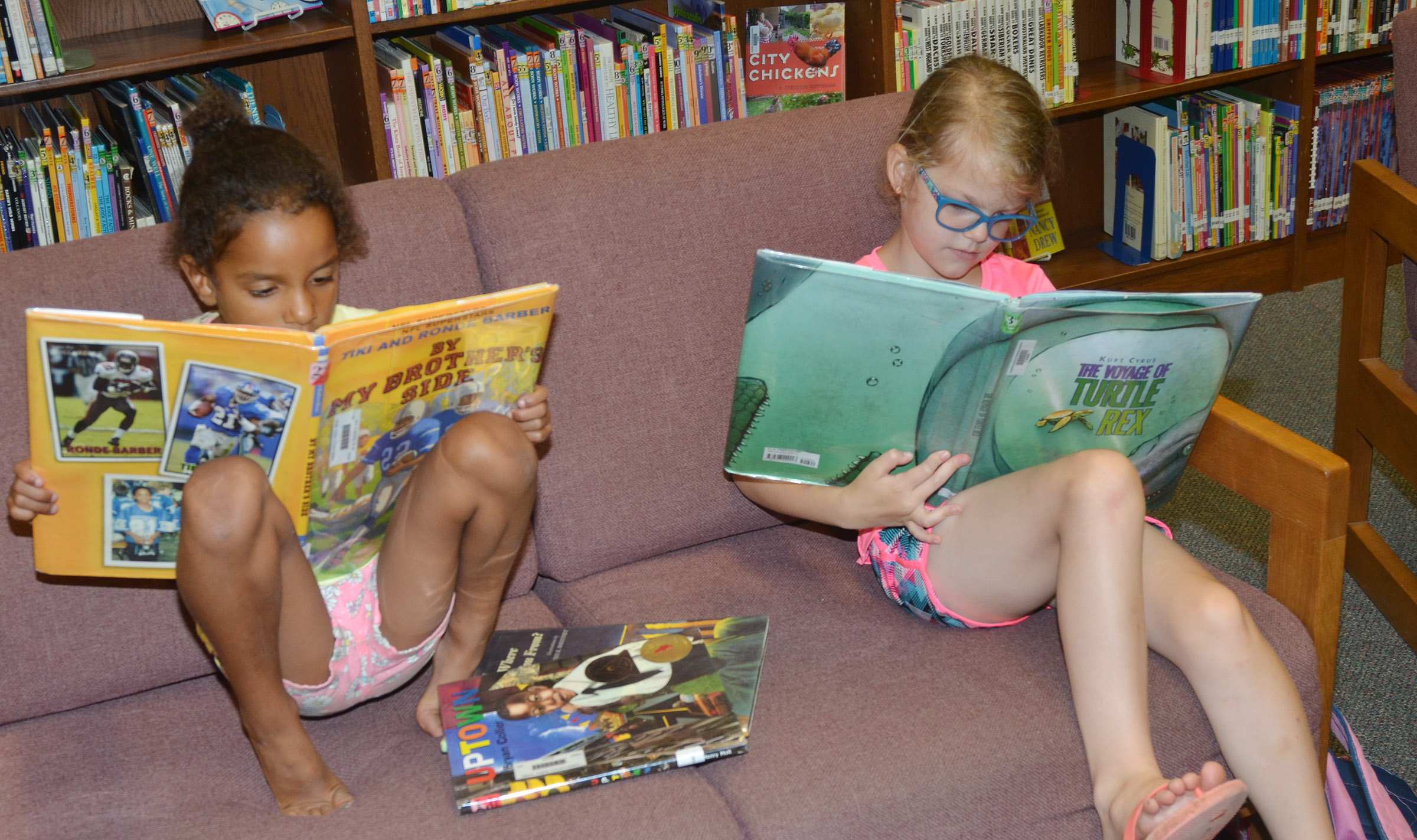 CES kindergarteners Kaylee Thompson, at left, and Zoe Weddle read.
