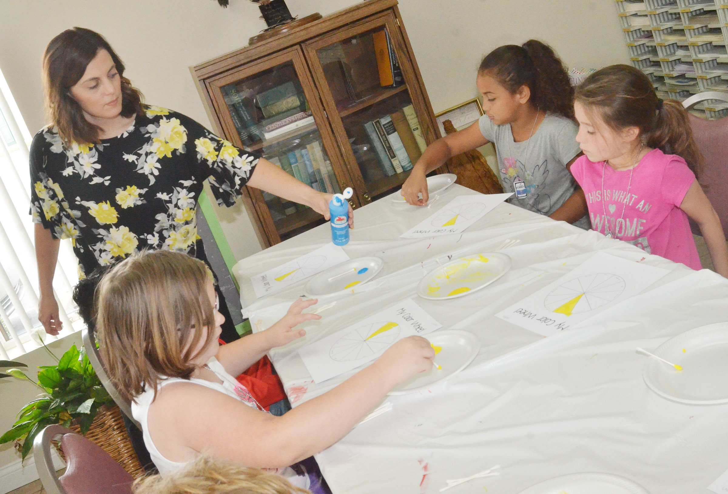 Audrey Myers, extension agent for family and consumer science at Taylor County Extension Office, helps students create their own color wheel.