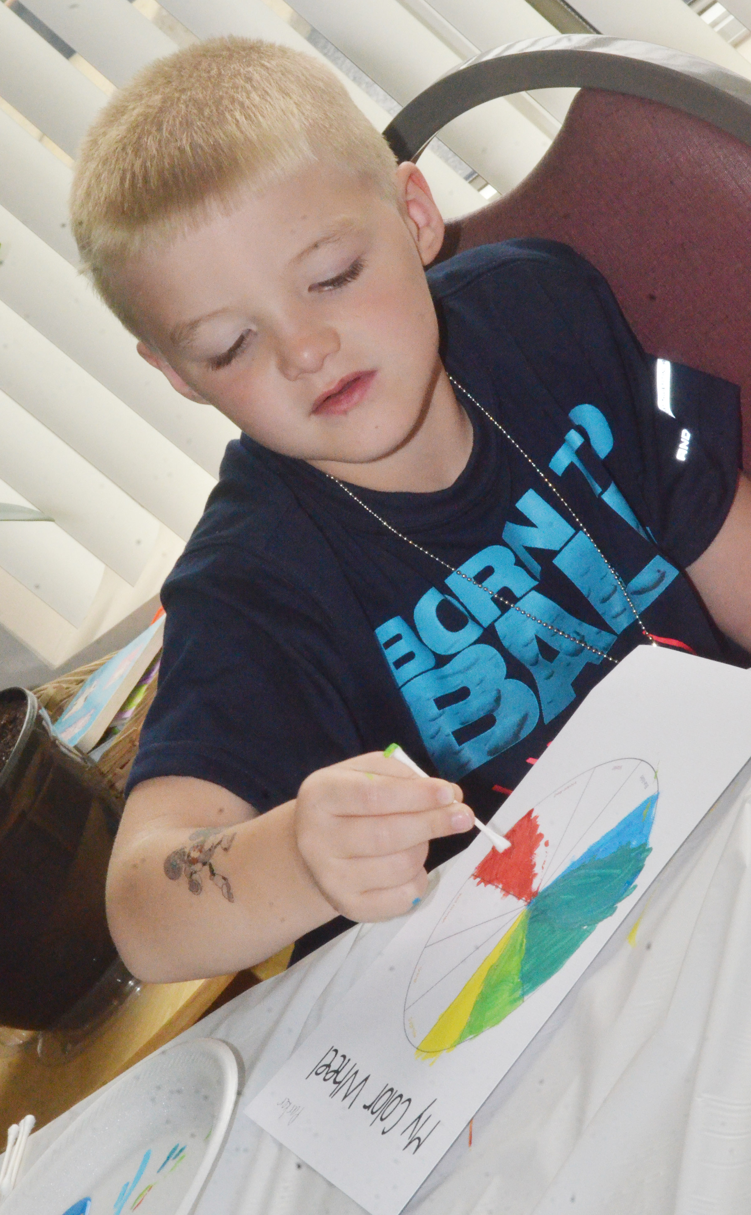 CES first-grader Parker Scharbrough creates his own color wheel.