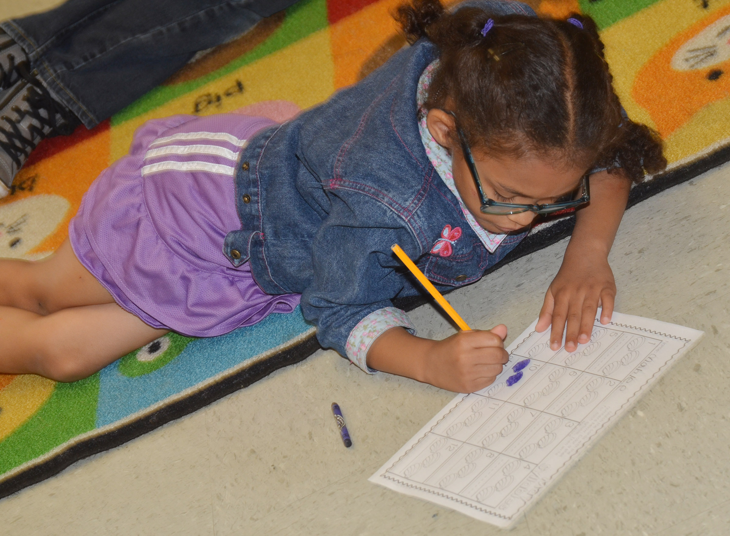 CES kindergartener Marlee Dickens practices counting.