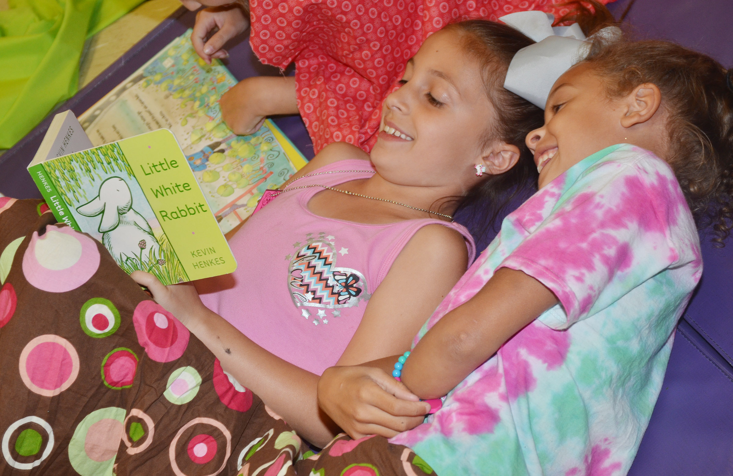 CES first-graders Lillian Martin, at left, and Keiava Thompson read together.