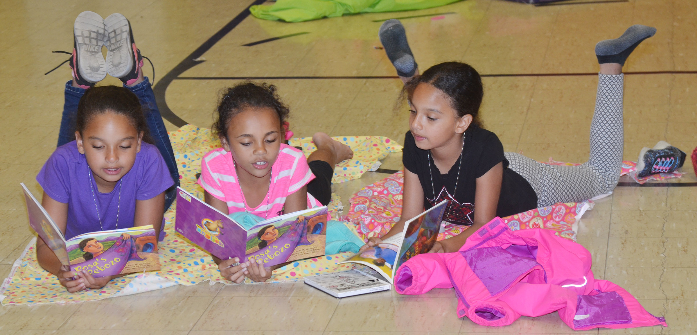 CES third-graders, from left, Aleecia Knezevic, Braelyn Taylor and Alyssa Knezevic read together.