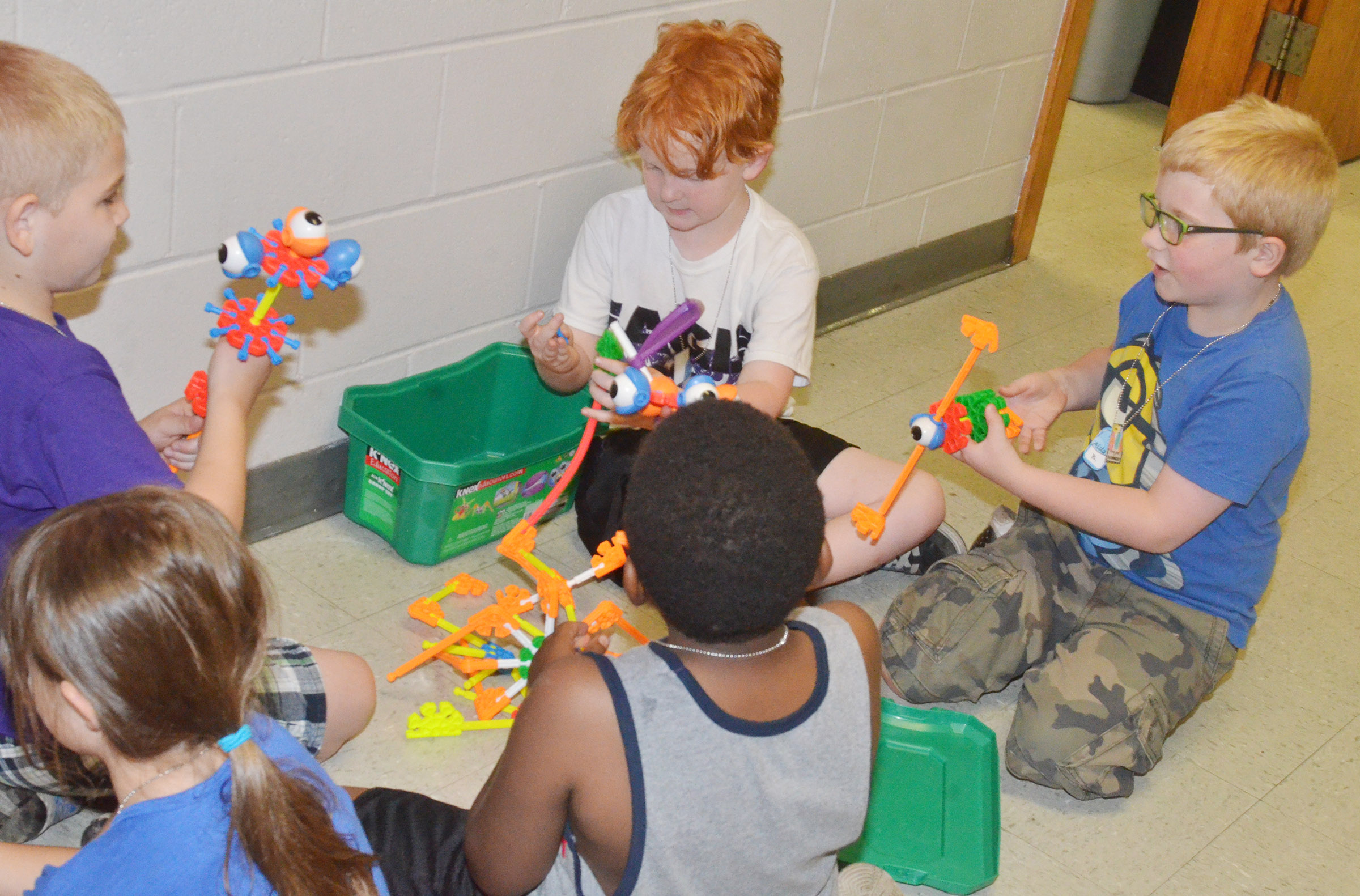 From left, CES second-graders Joseph Greer, Gavin Martin and Aidan Bowles and their classmates build together.