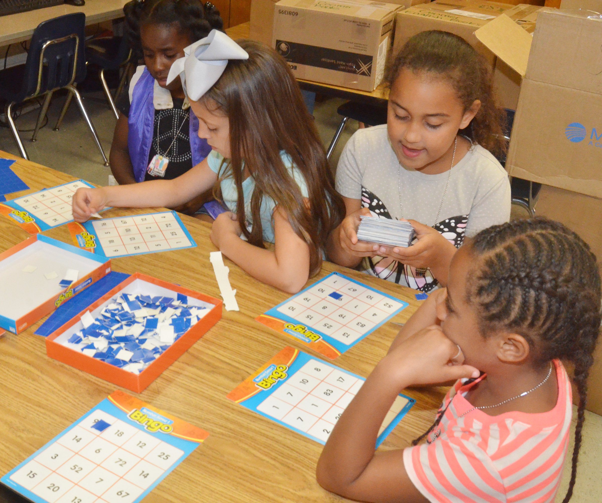 From left, CES first-graders Destini Gholston, Lillian Martin, Maleigha Travis and Kadance Ford play math bingo.