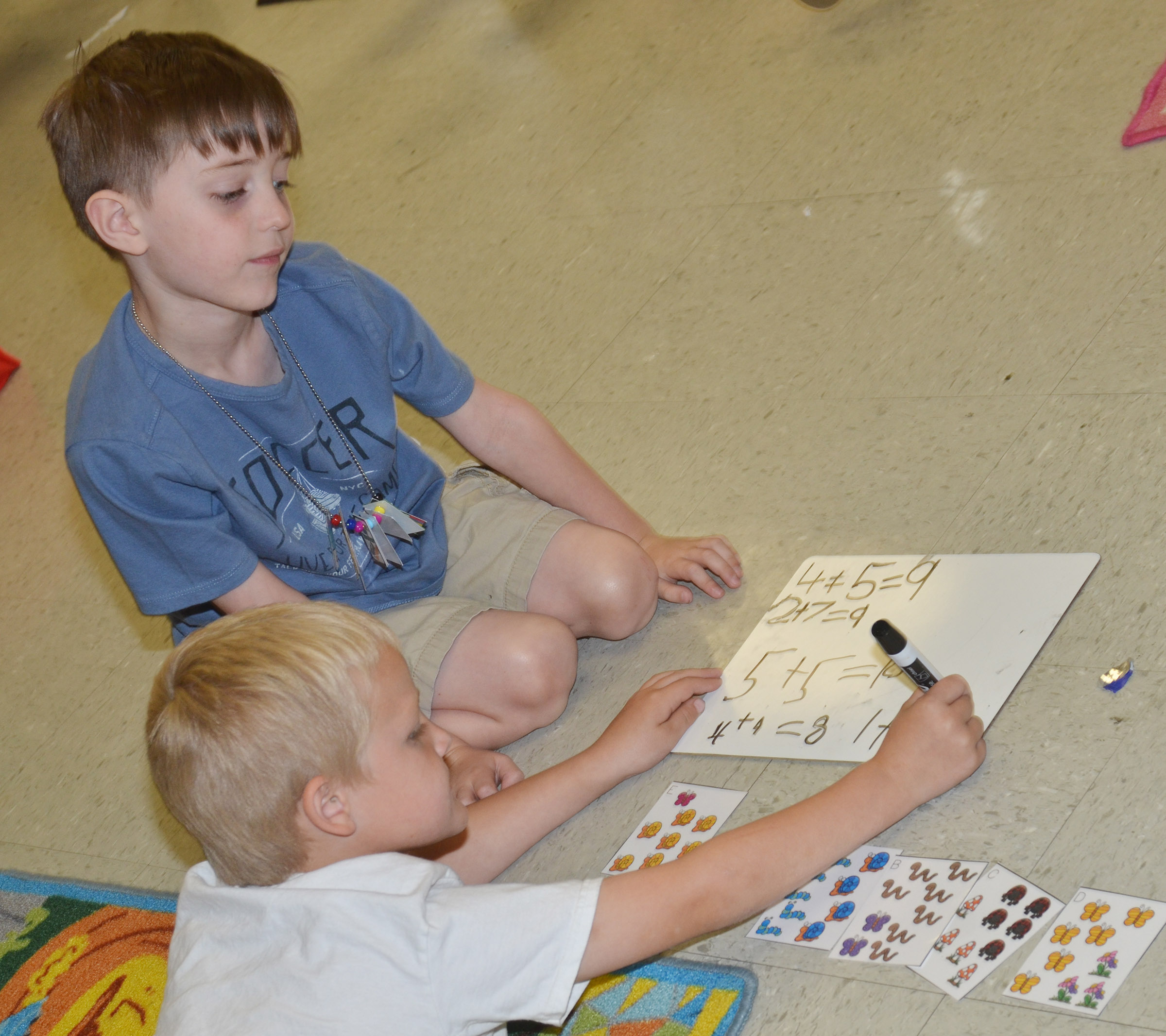 CES kindergarteners Tristian Harris, at left, and Caleb Goodson work math problems.