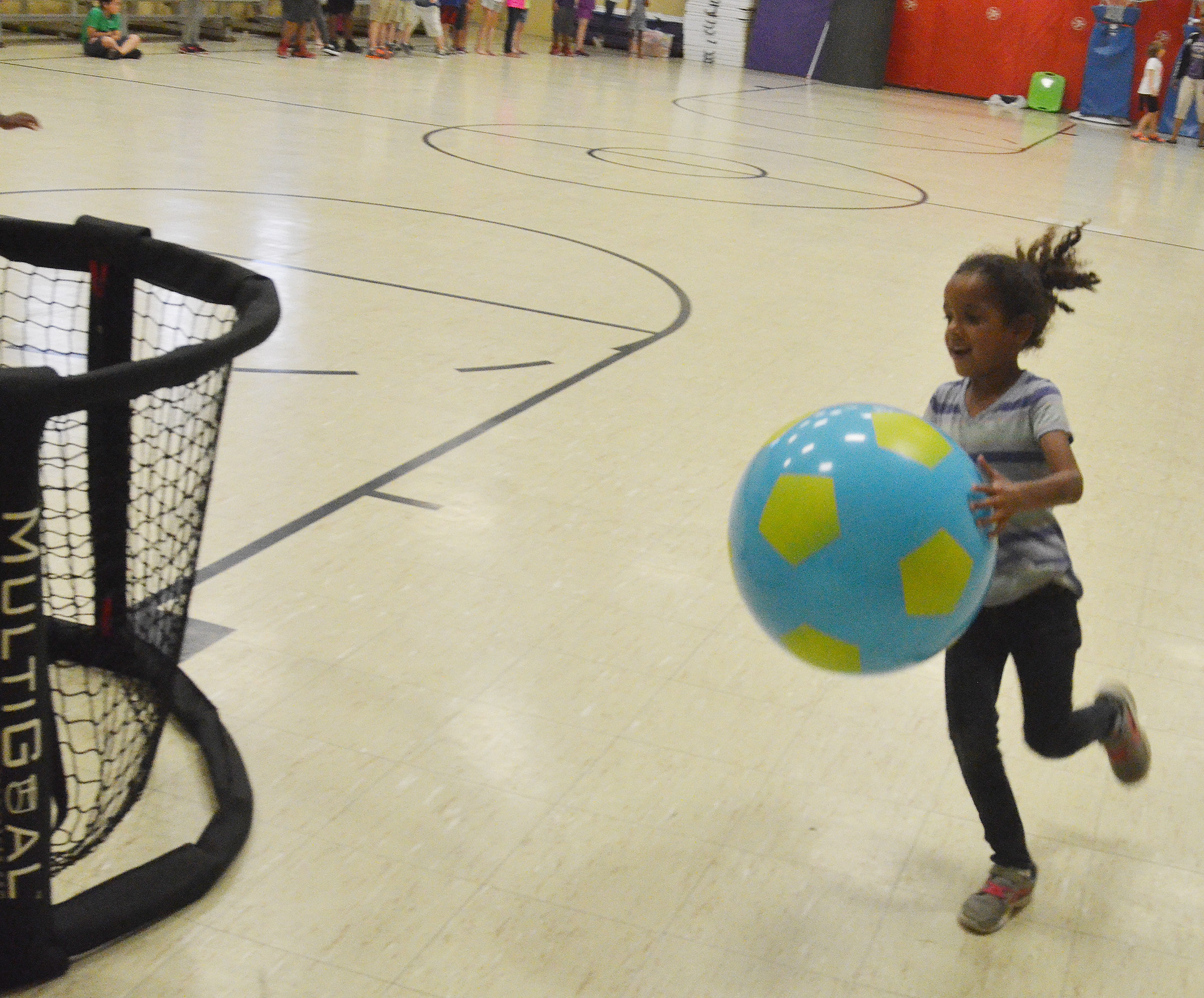 CES kindergartener Kylei Thompson runs a relay race.