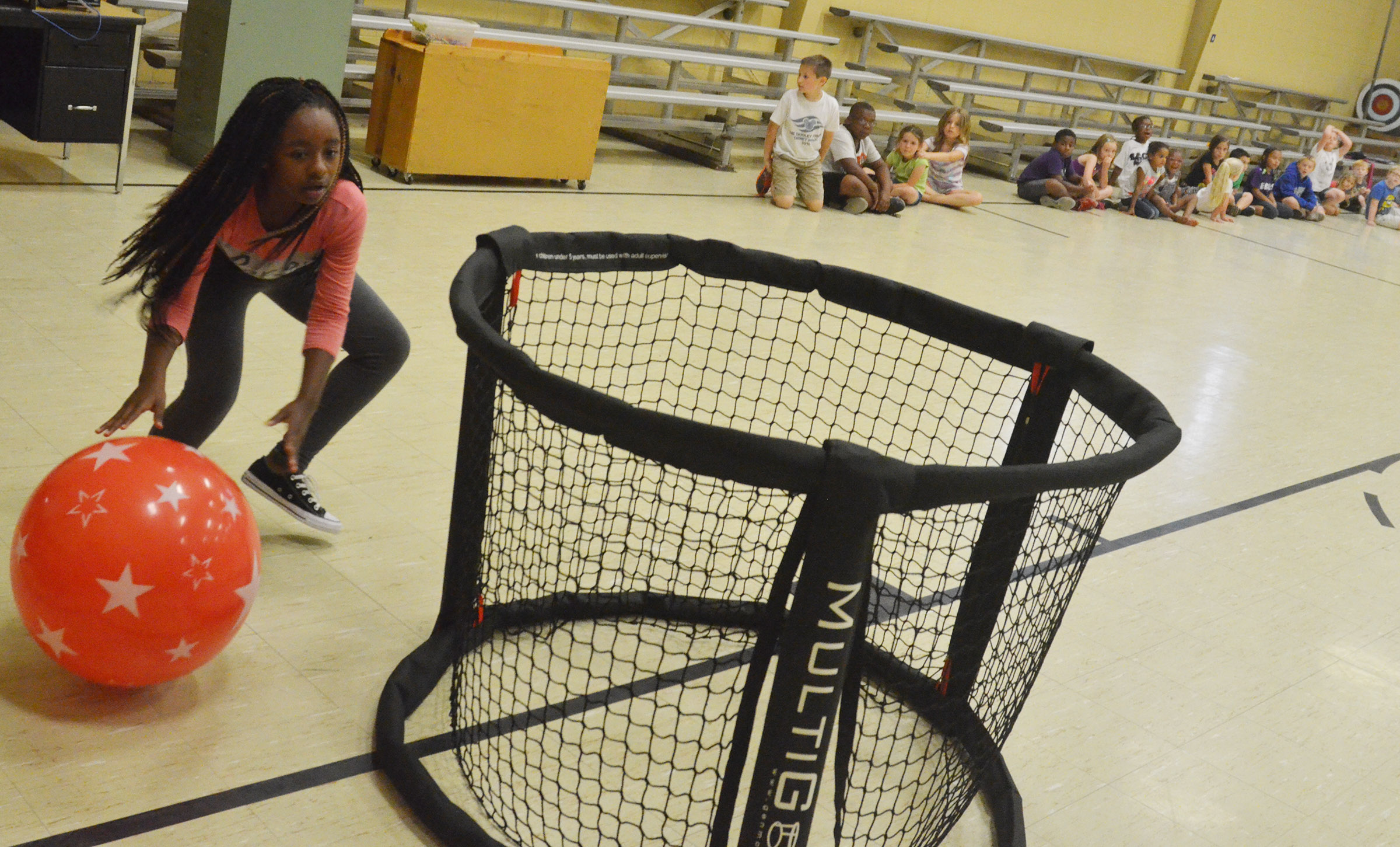 CES third-grader Tiffani Gaddie runs a relay race.