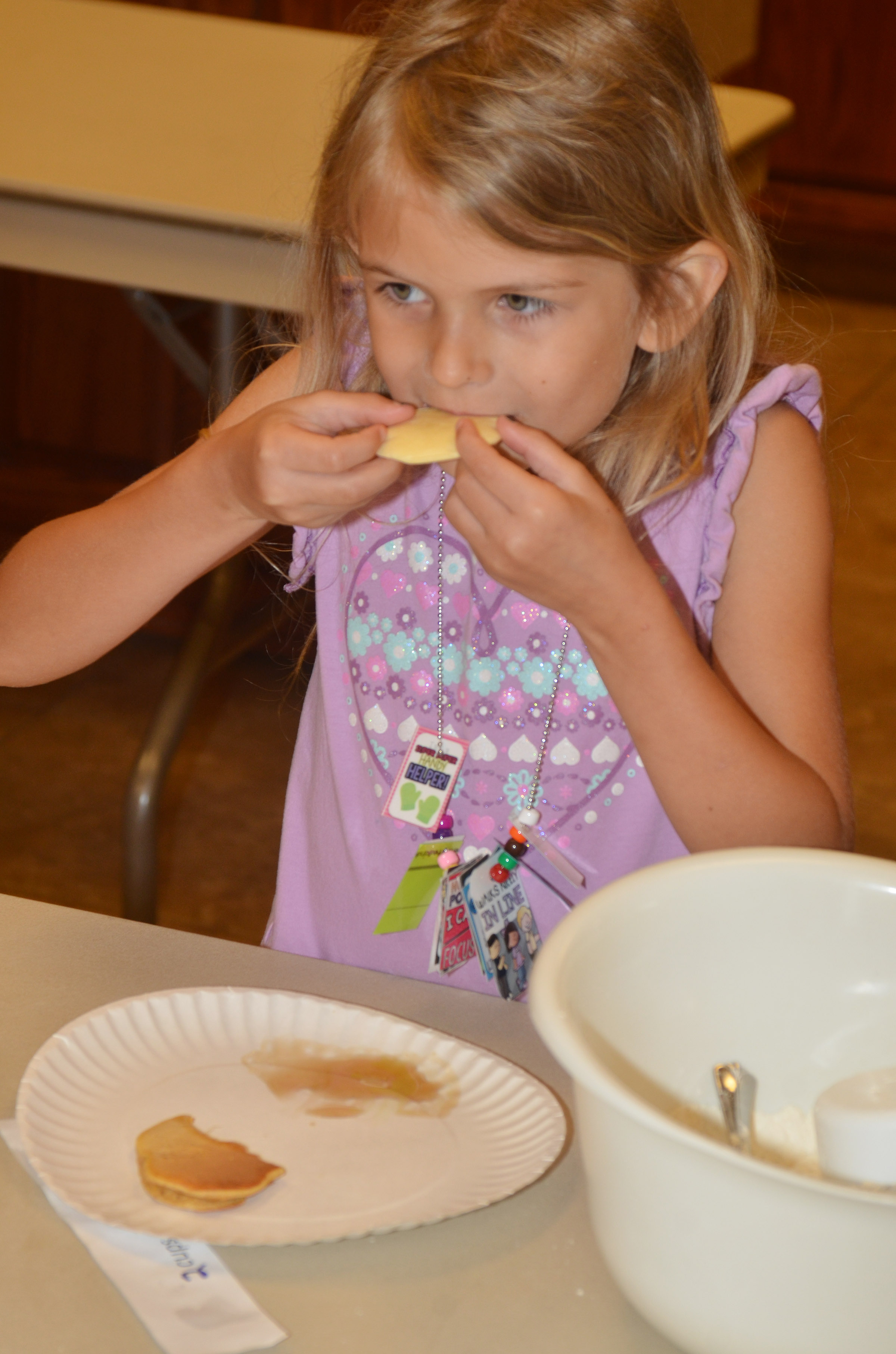 CES kindergartener Madie Gebler samples a pancake she made.