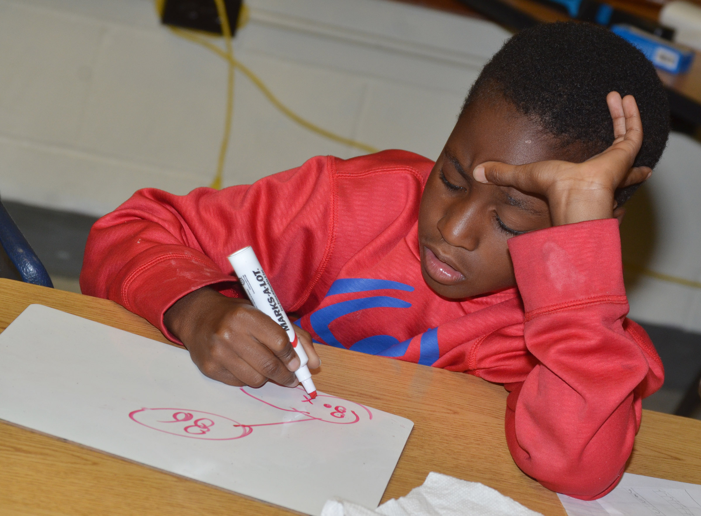 CES third-grader John Gholston works a math problem.