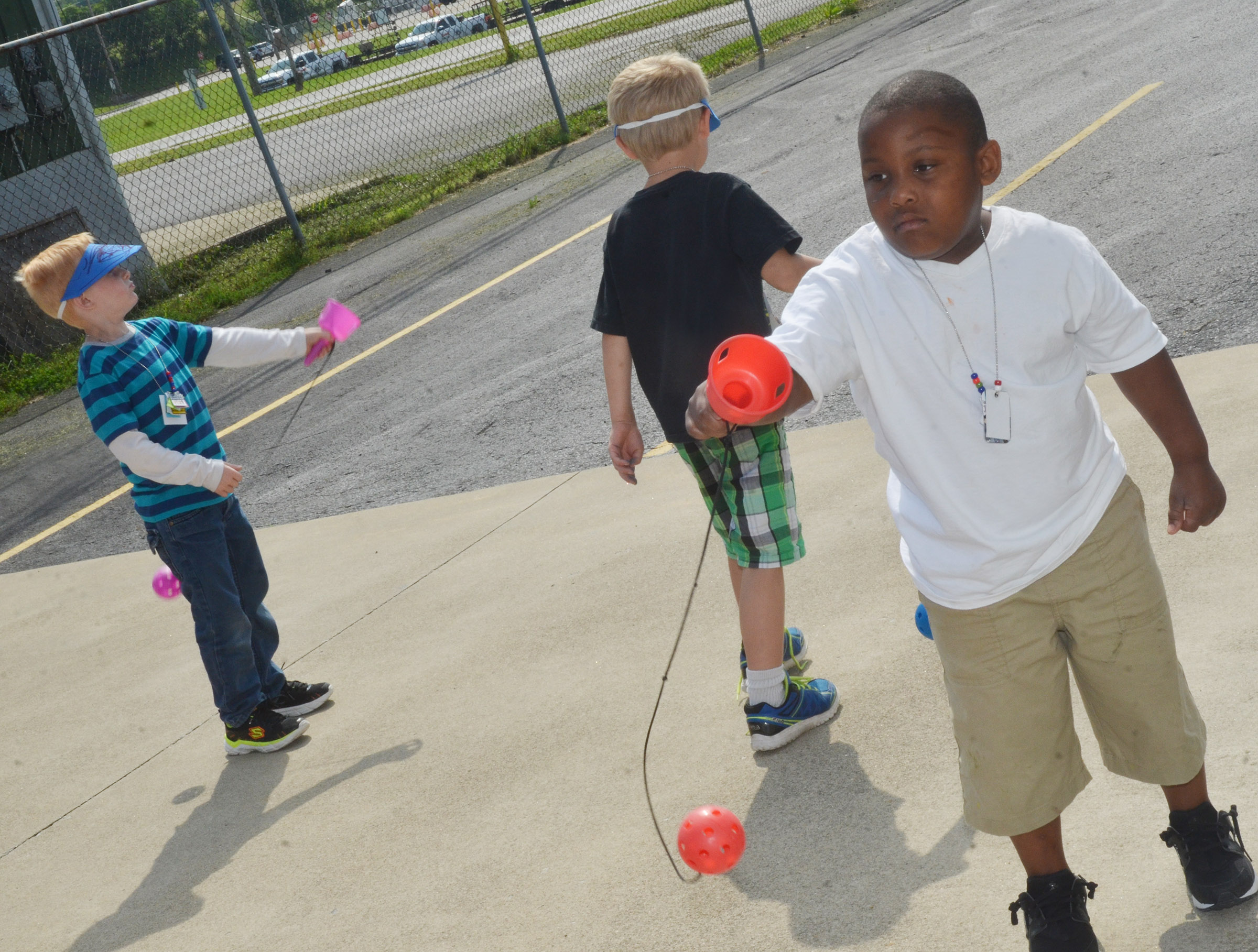 CES kindergartener Malachi Conner tries to catch a ball in his cup.