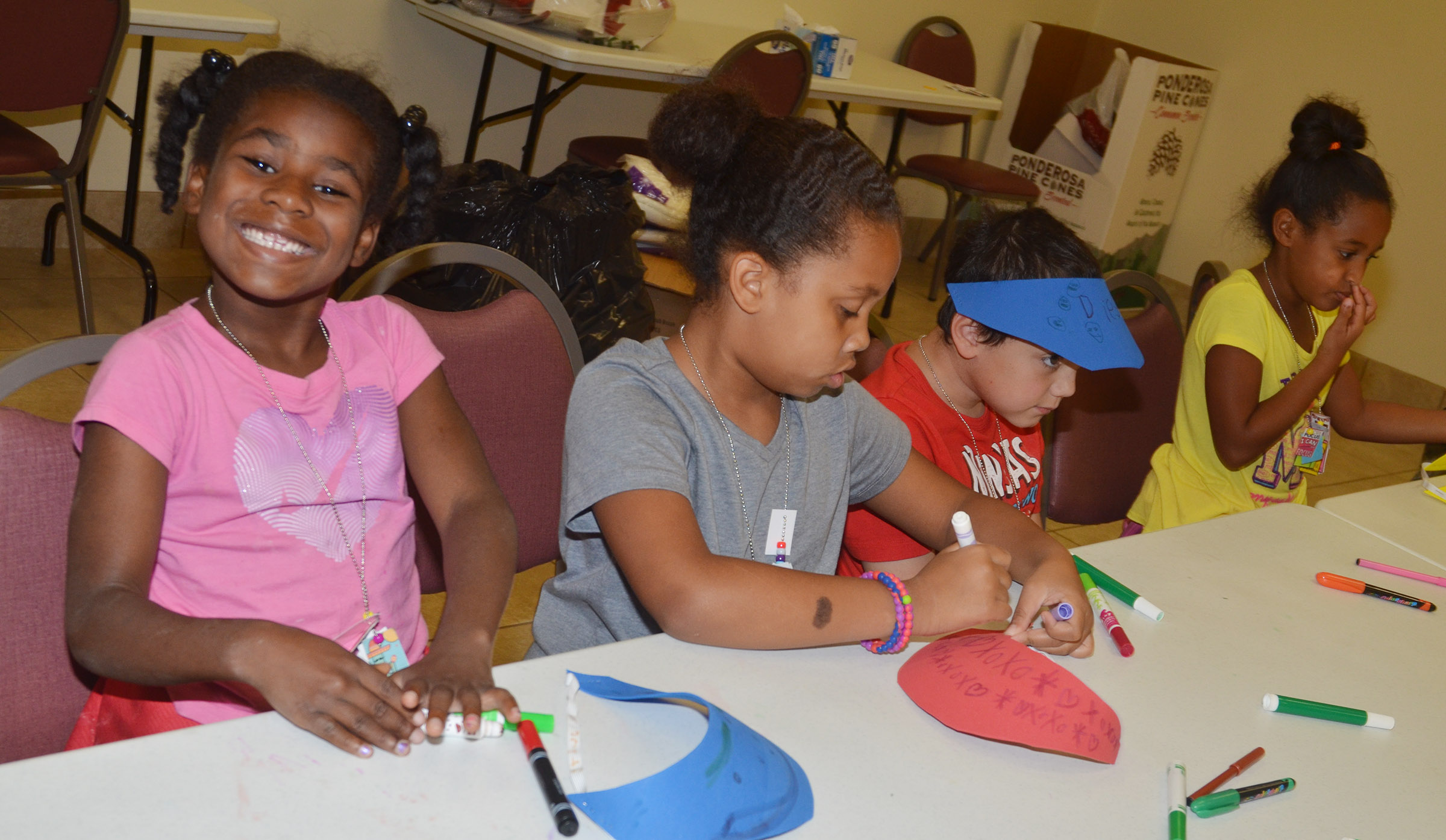 CES first-grader Destini Gholston is all smiles as she and her classmates make hats together.