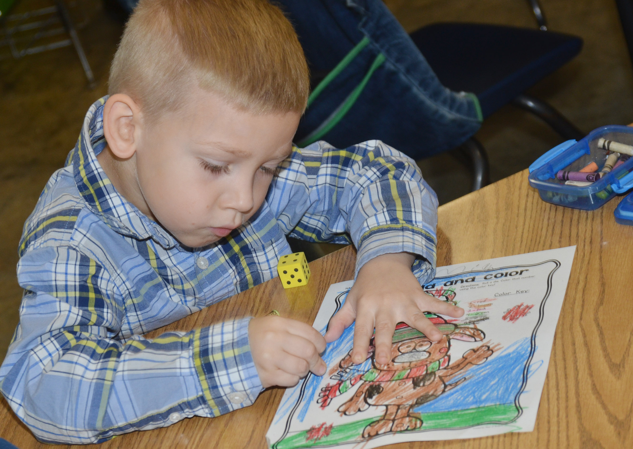 CES kindergartener Jeremiah Stebelton uses a code to color his Christmas reindeer.