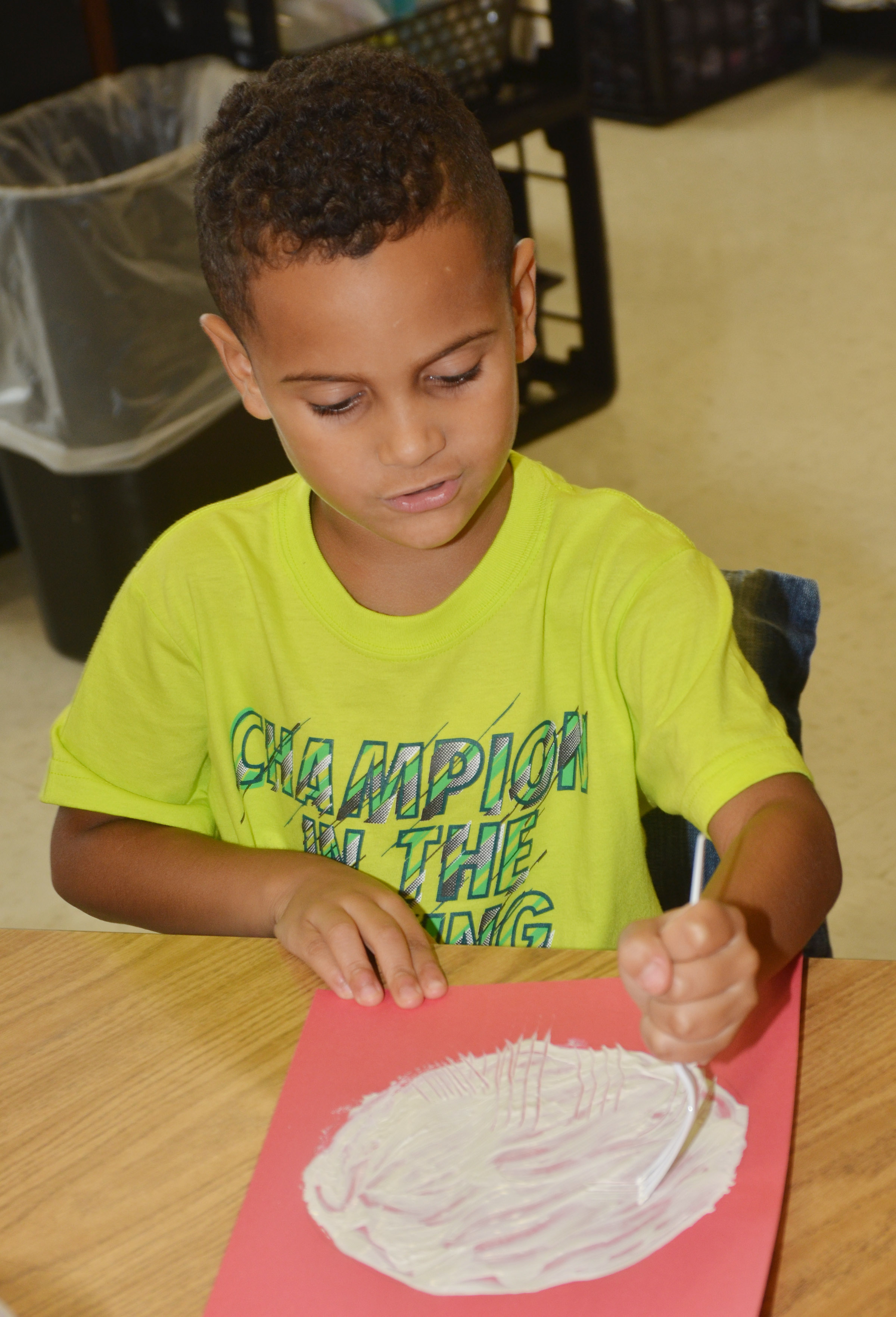 CES kindergartener Kingston Cowherd paints with a fork to make his panda's face.