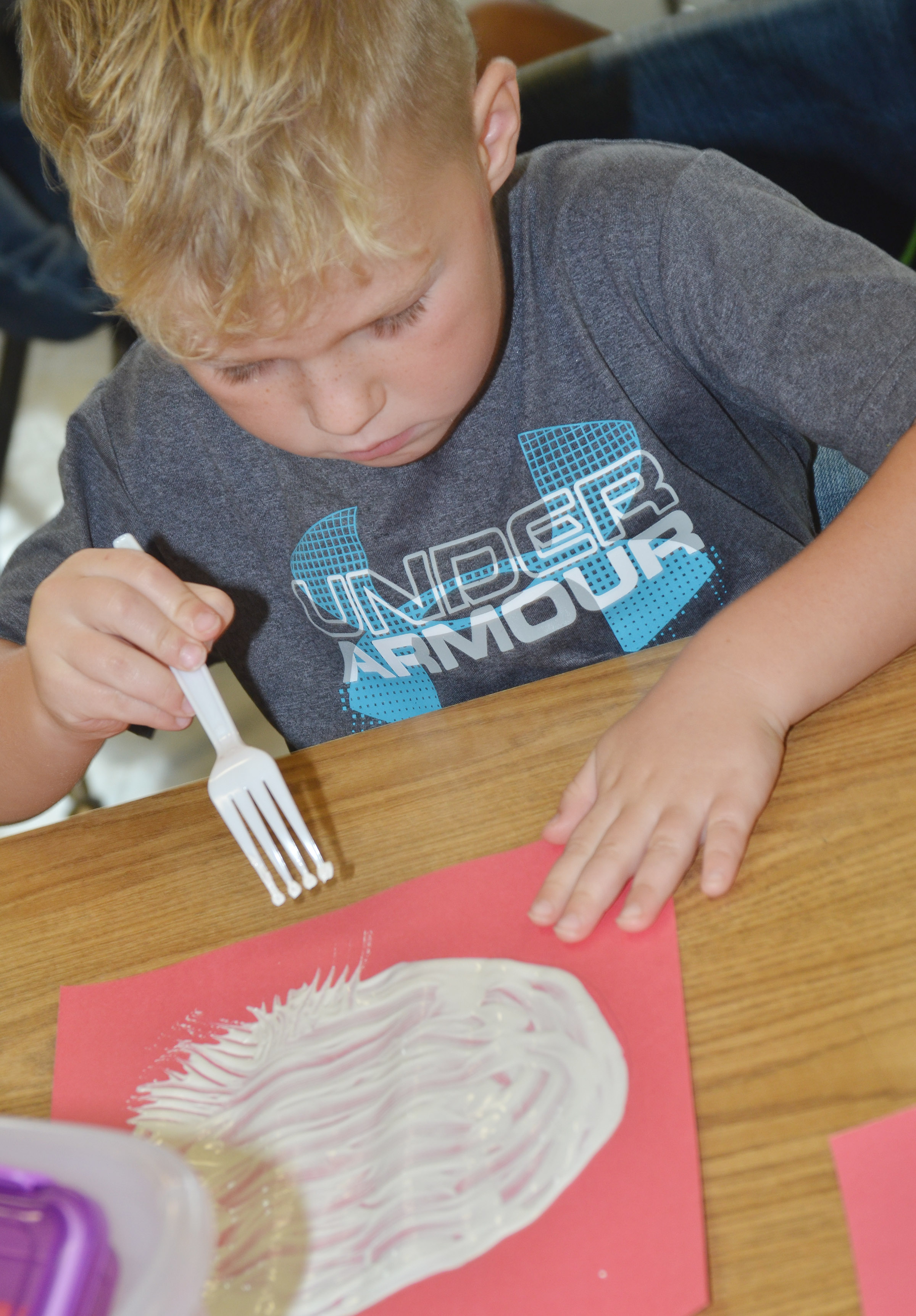 CES kindergartener Landry Brown paints with a fork to make his panda's face.