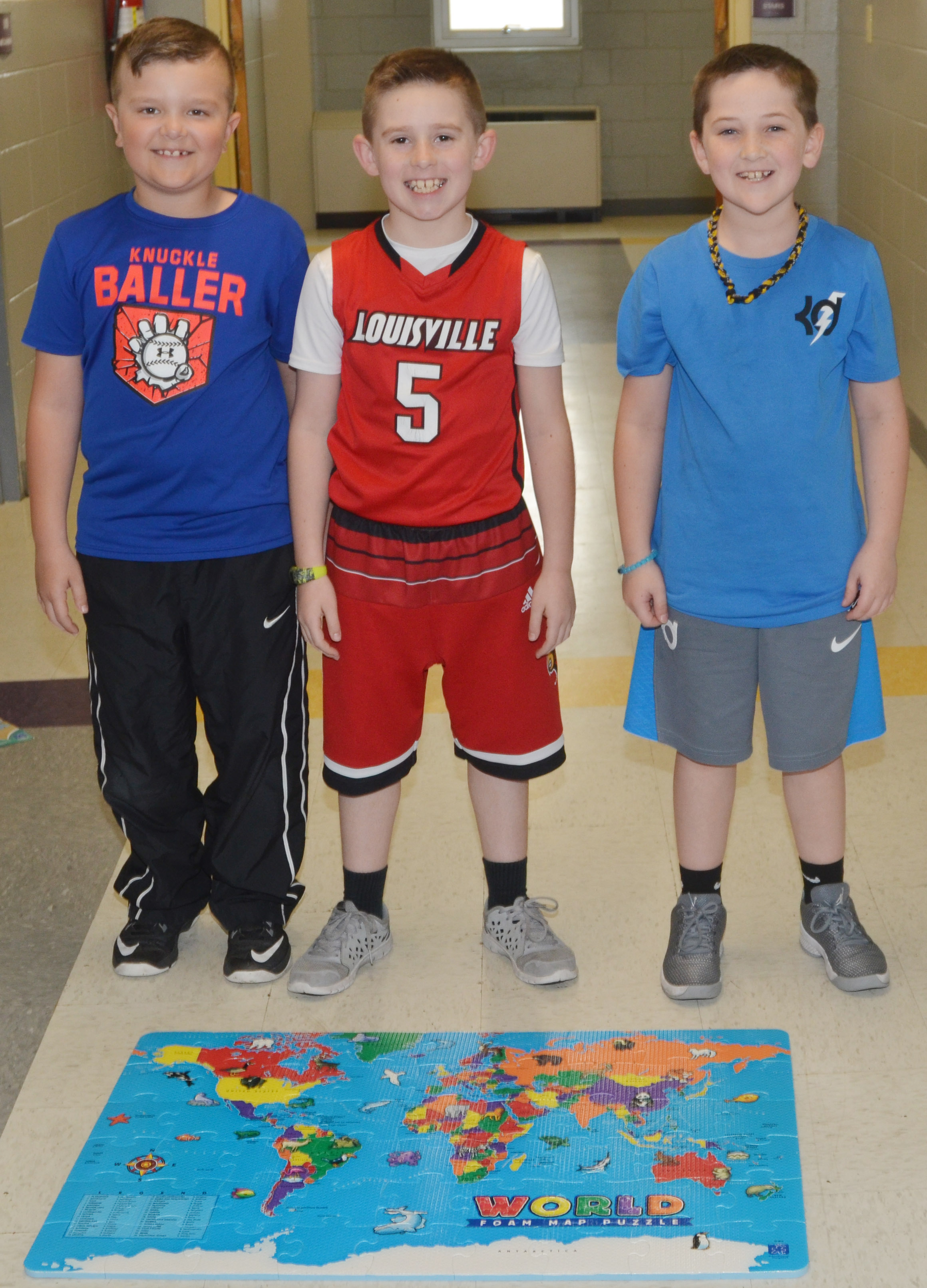 CES second-graders, from left, Cayton Lawhorn, Lanigan Price and Luke Adkins worked as a team to put together this world map puzzle.