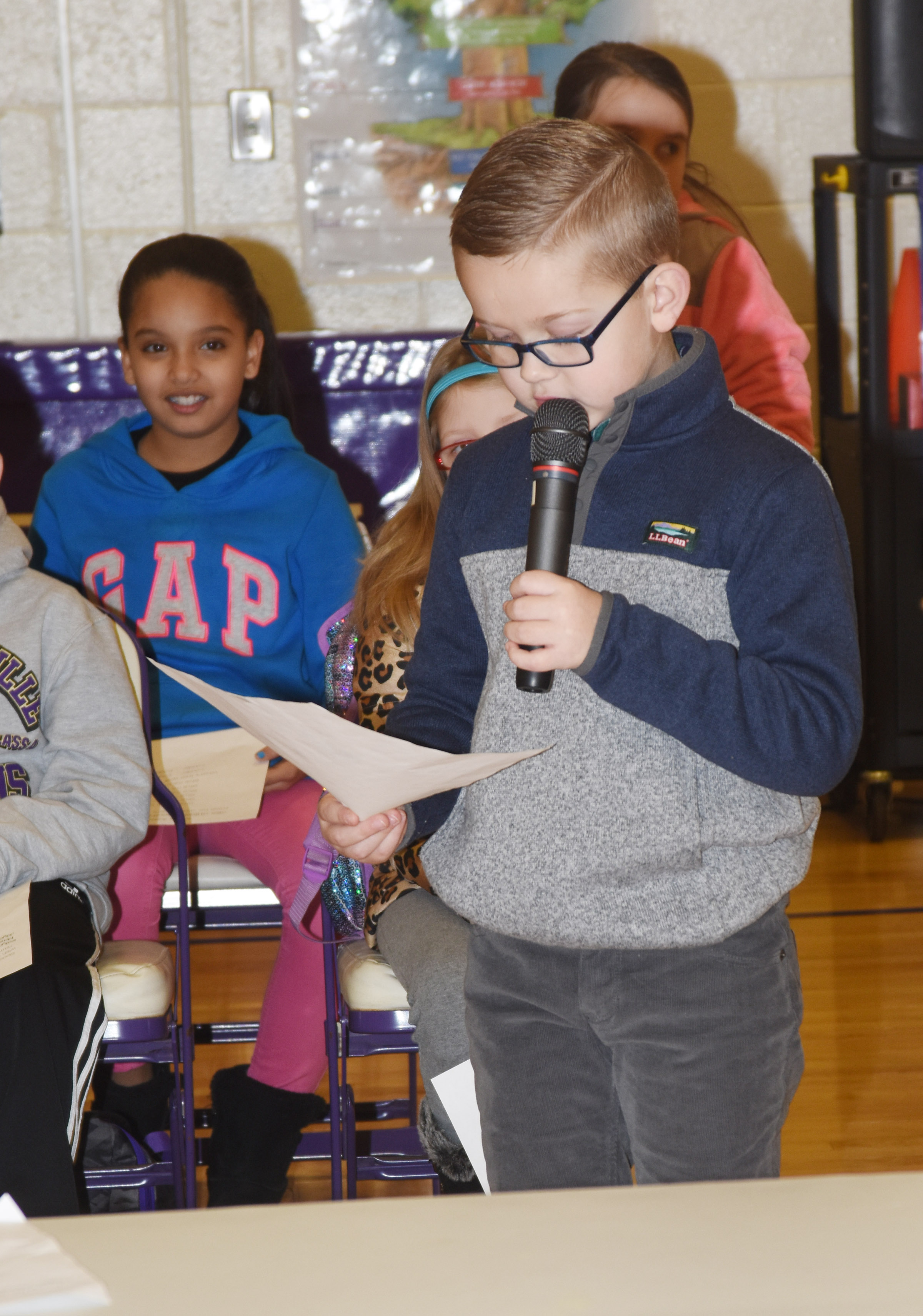 CES first-grader John Hagan Newton reads his essay about how he enjoys snow during the winter.