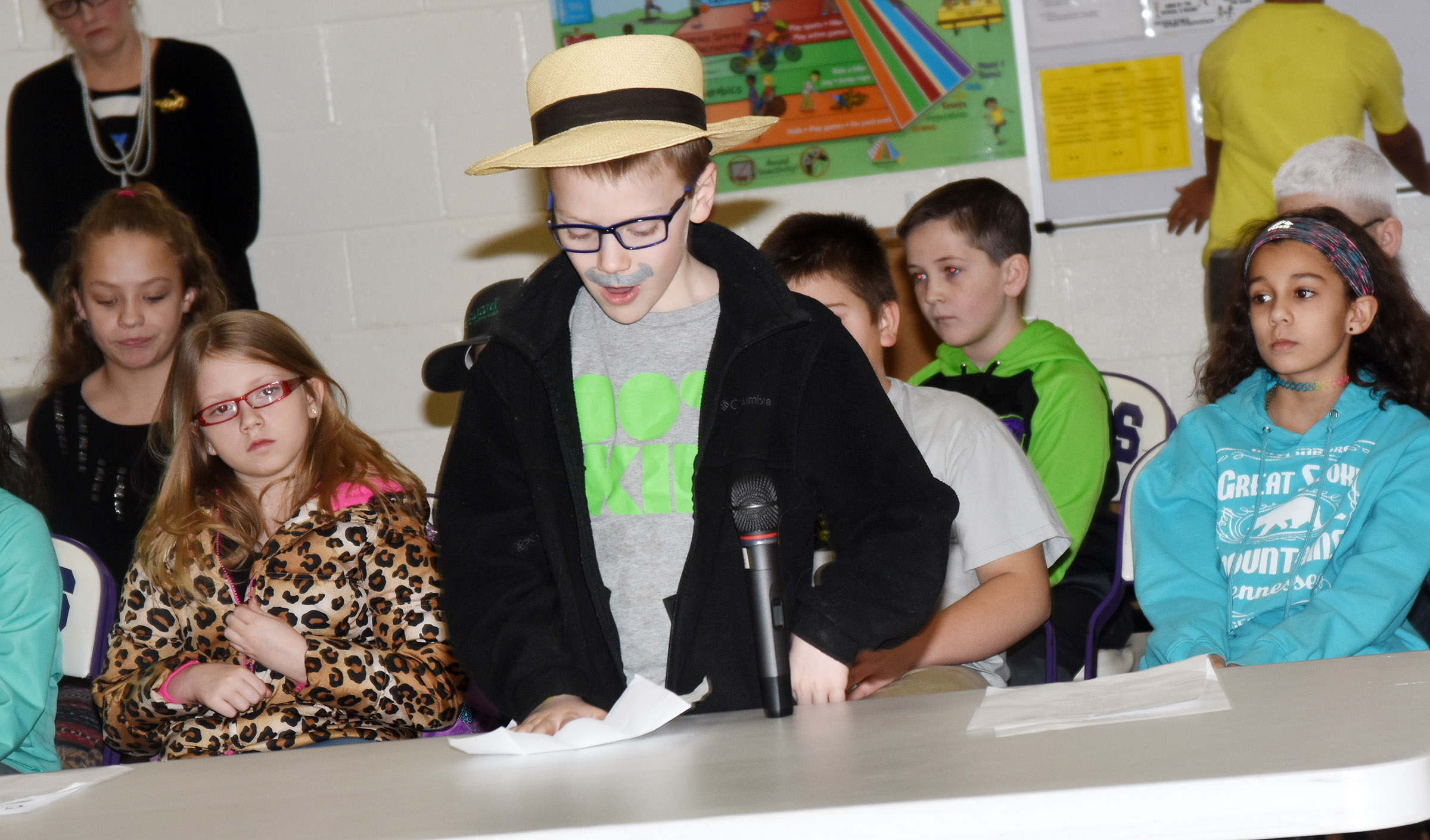 CES fourth-grader Connor Coots reads his essay about the 100th day of school.