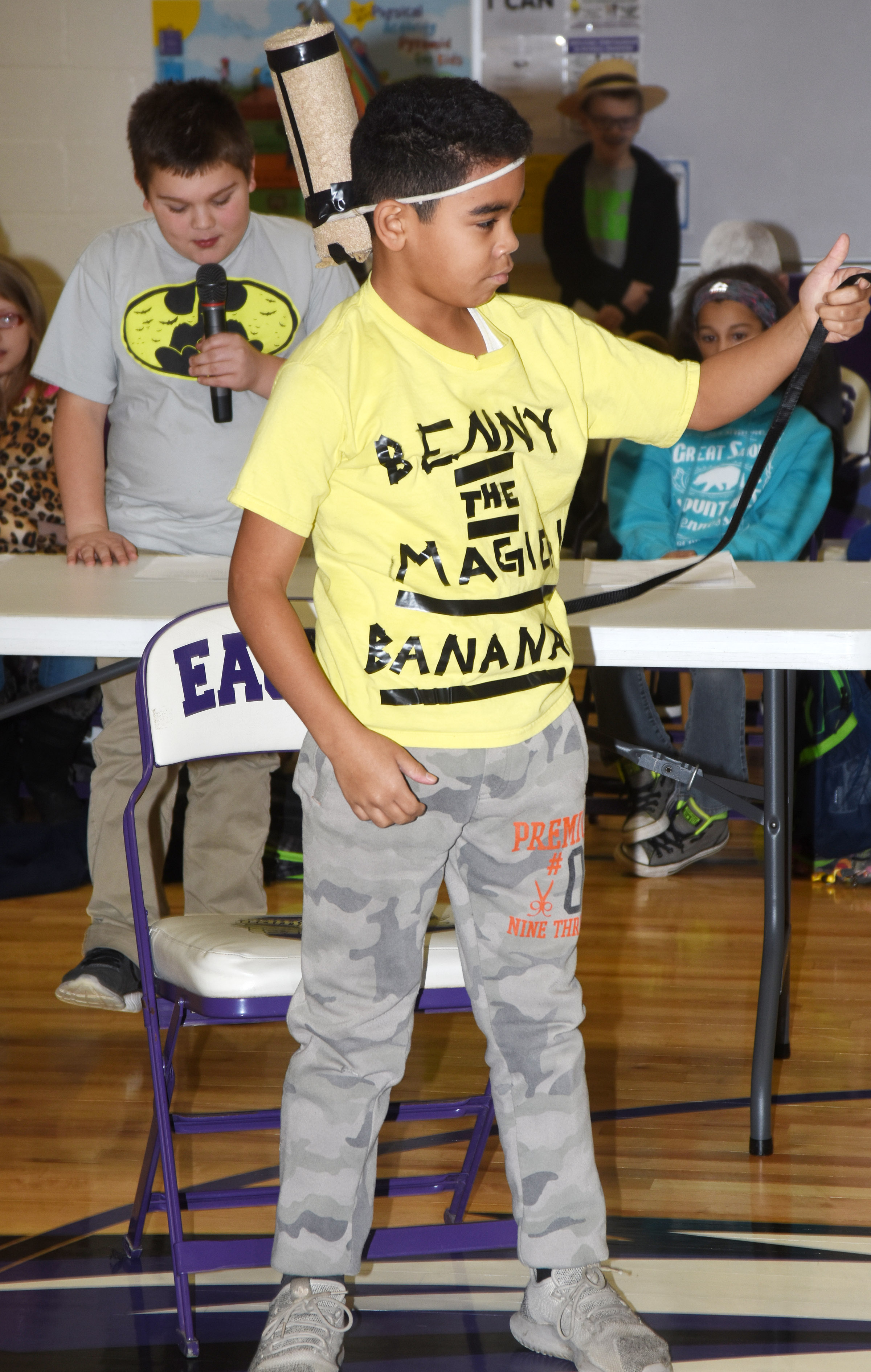 CES fifth-grader Gabriel Noyola performs his skit about Benny the magic banana as classmate Logan England narrates.
