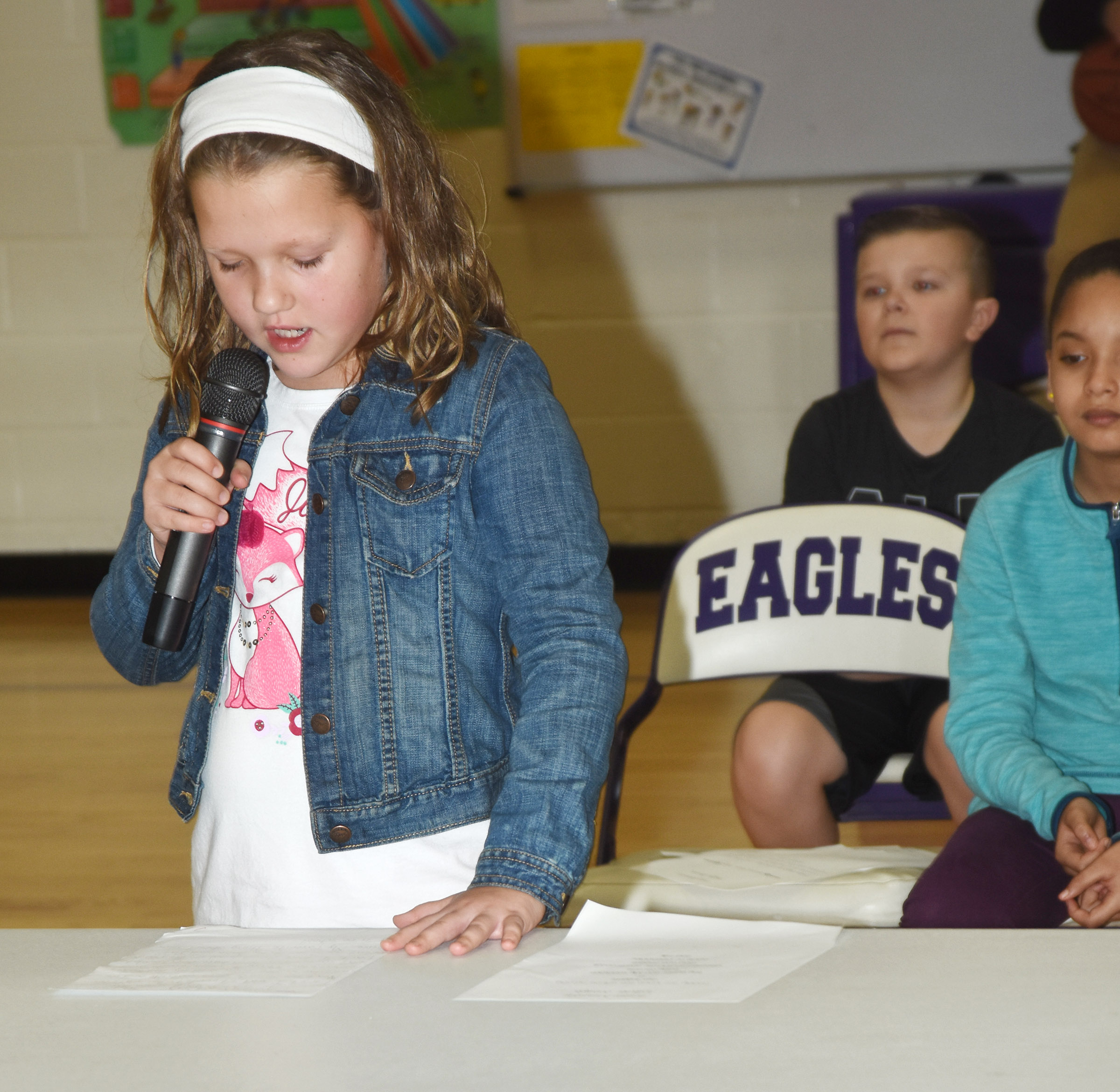 CES third-grader Madison Smith reads her essay about why she enjoys snow days.