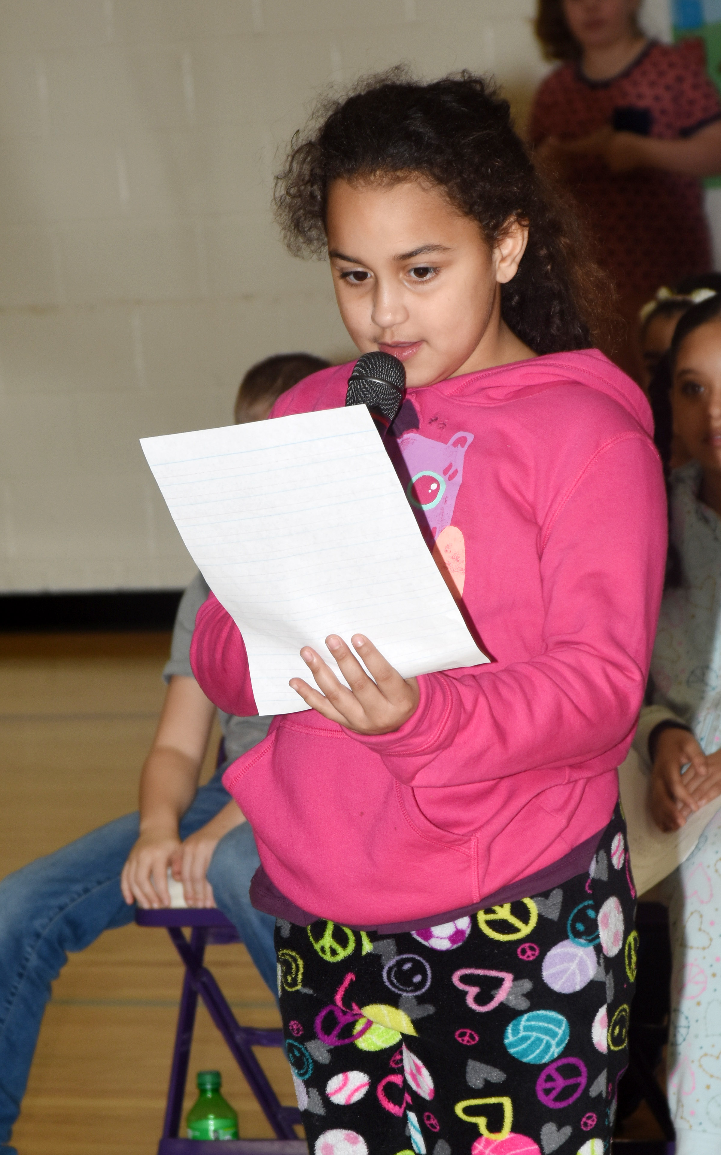 CES second-grader Maleigha Travis reads her letter thanking her teachers for all they do for her and her classmates.