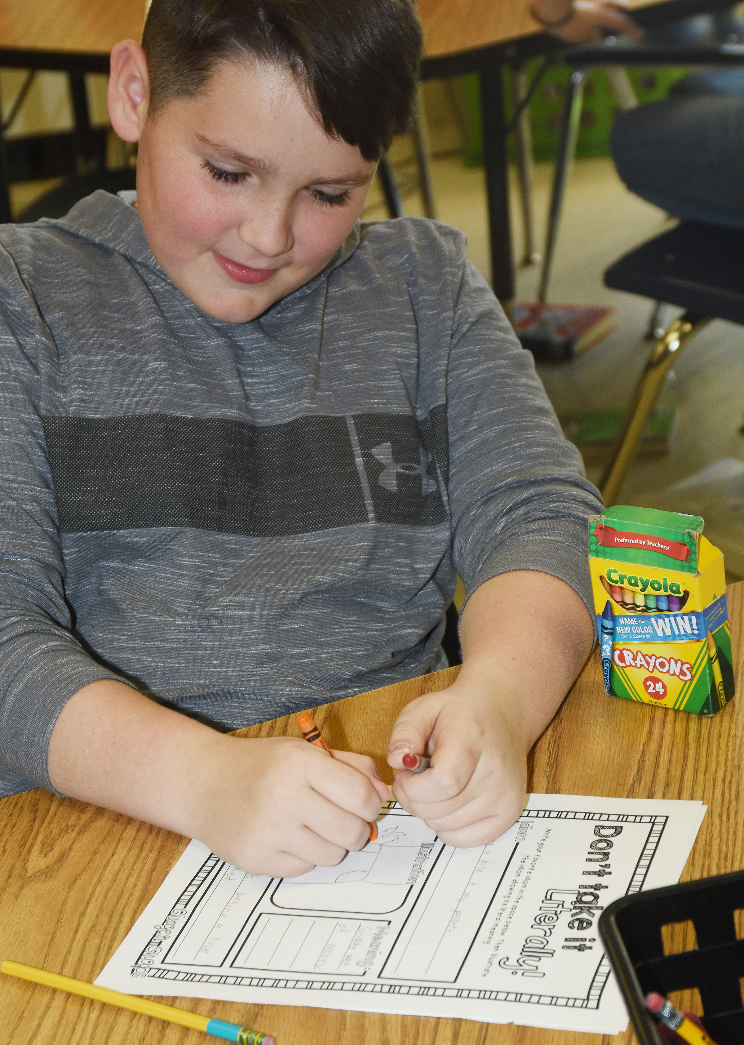"CES fourth-grader Ethan Garrison draws a picture of the idiom ""burning a hole in my pocket."""