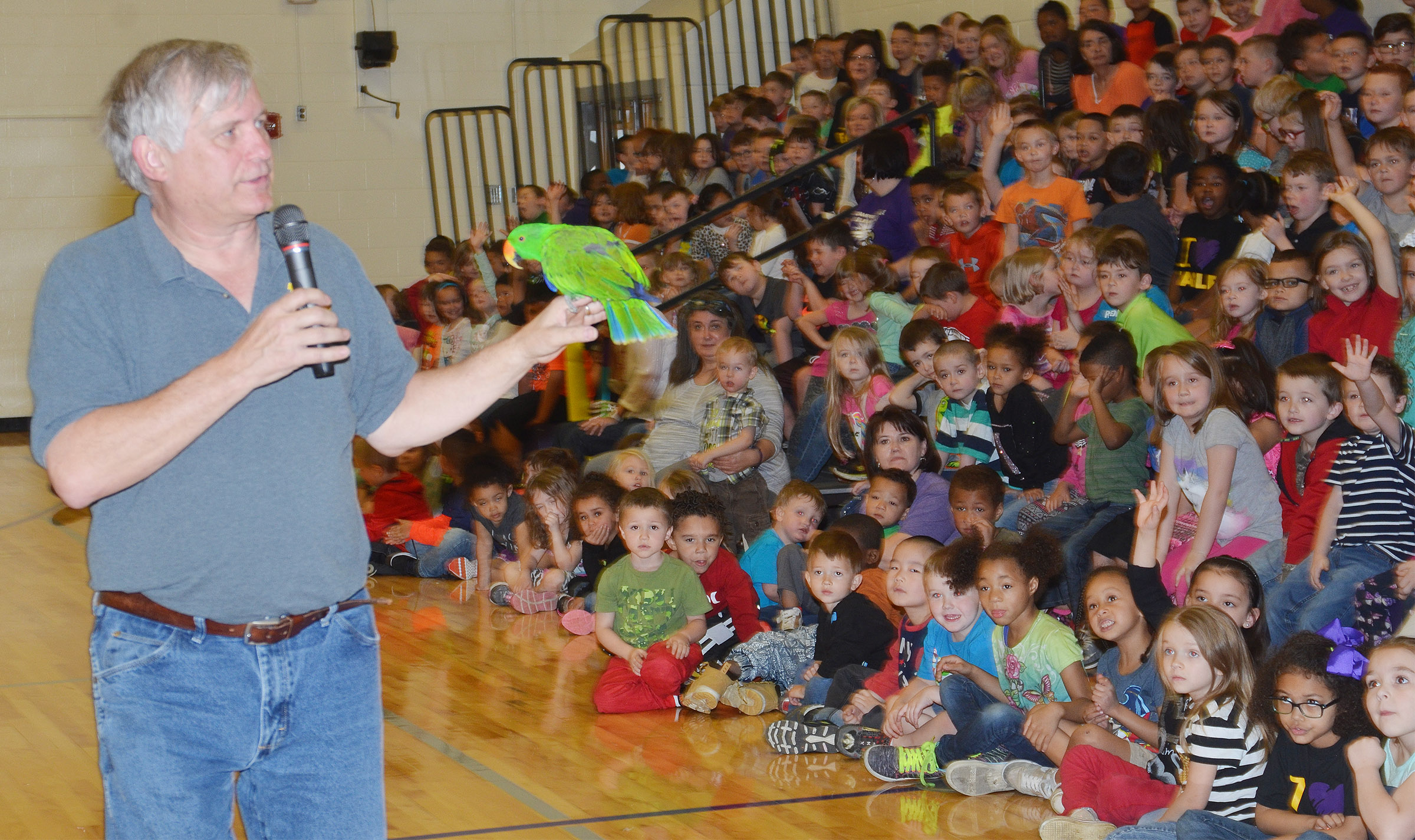 Steven Thomas of Zoodles animal education program shows CES students a parrot name Solomon.