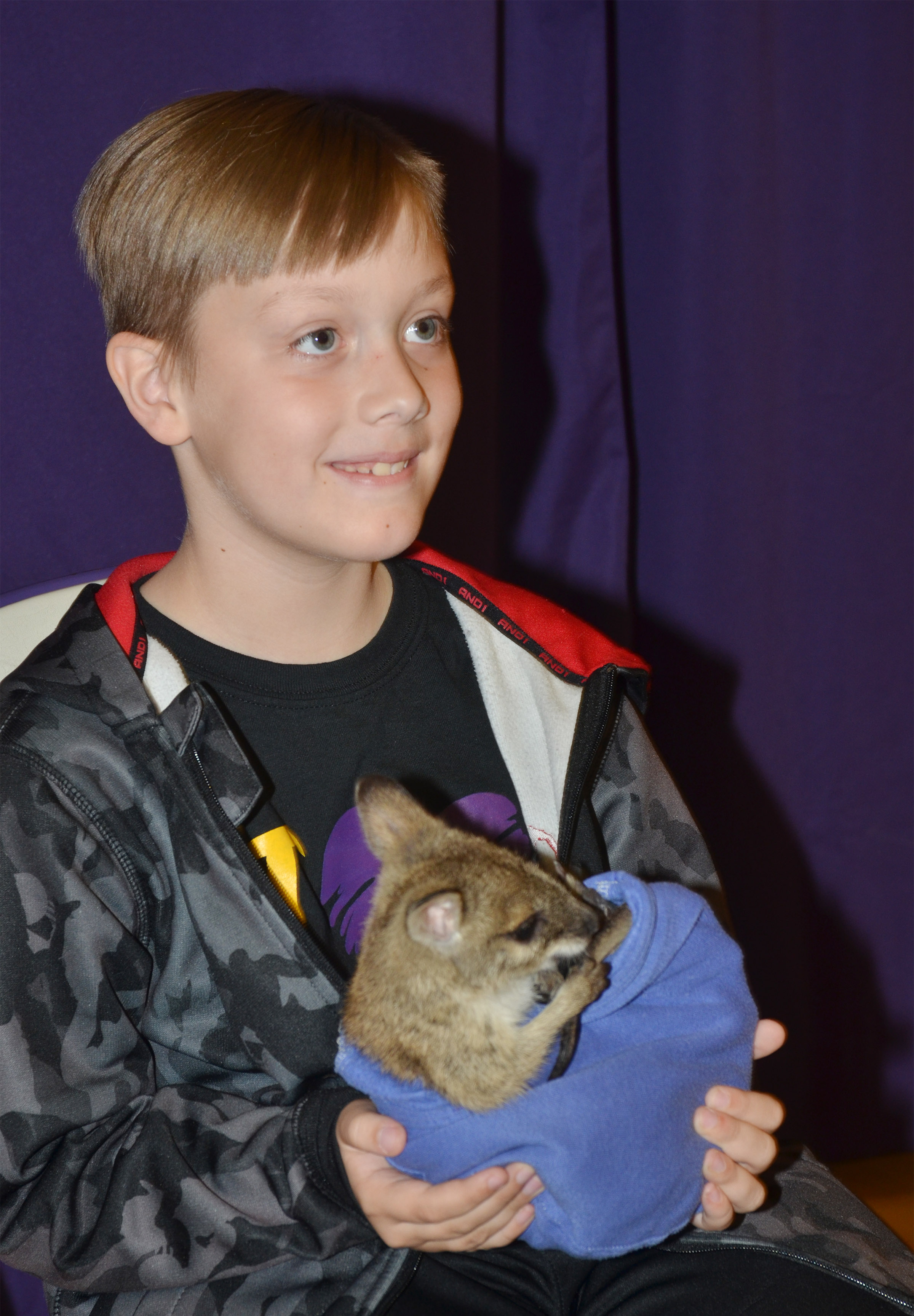 CES third-grader Izak Burress holds Wendy the baby kangaroo.