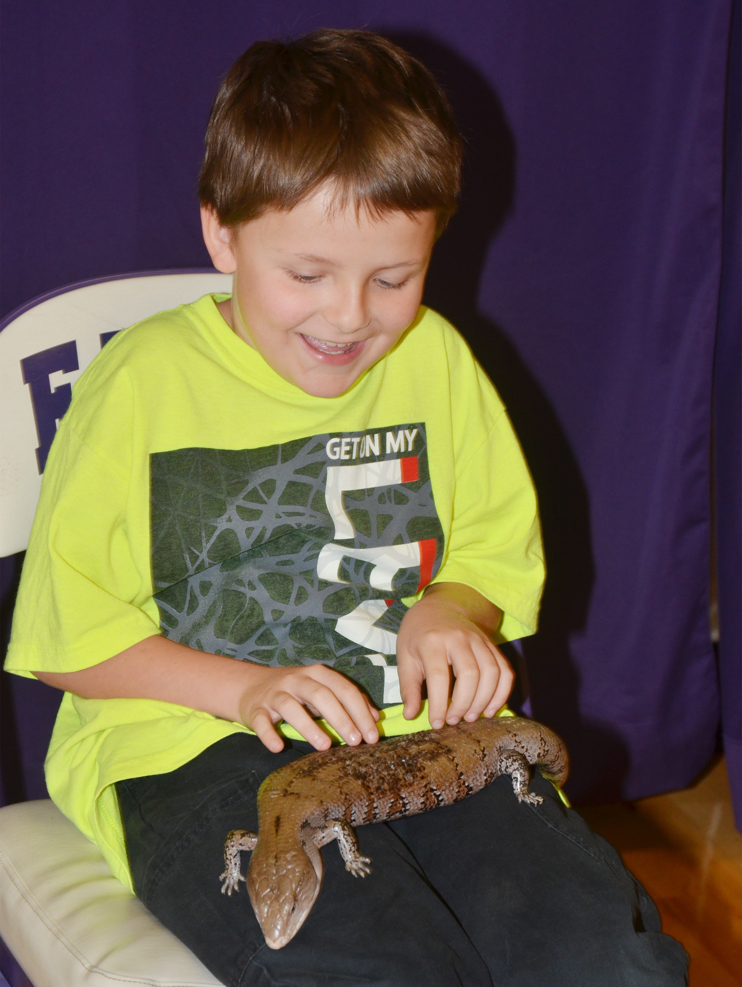 CES third-grader Jace Cox holds the blue tongue skink.