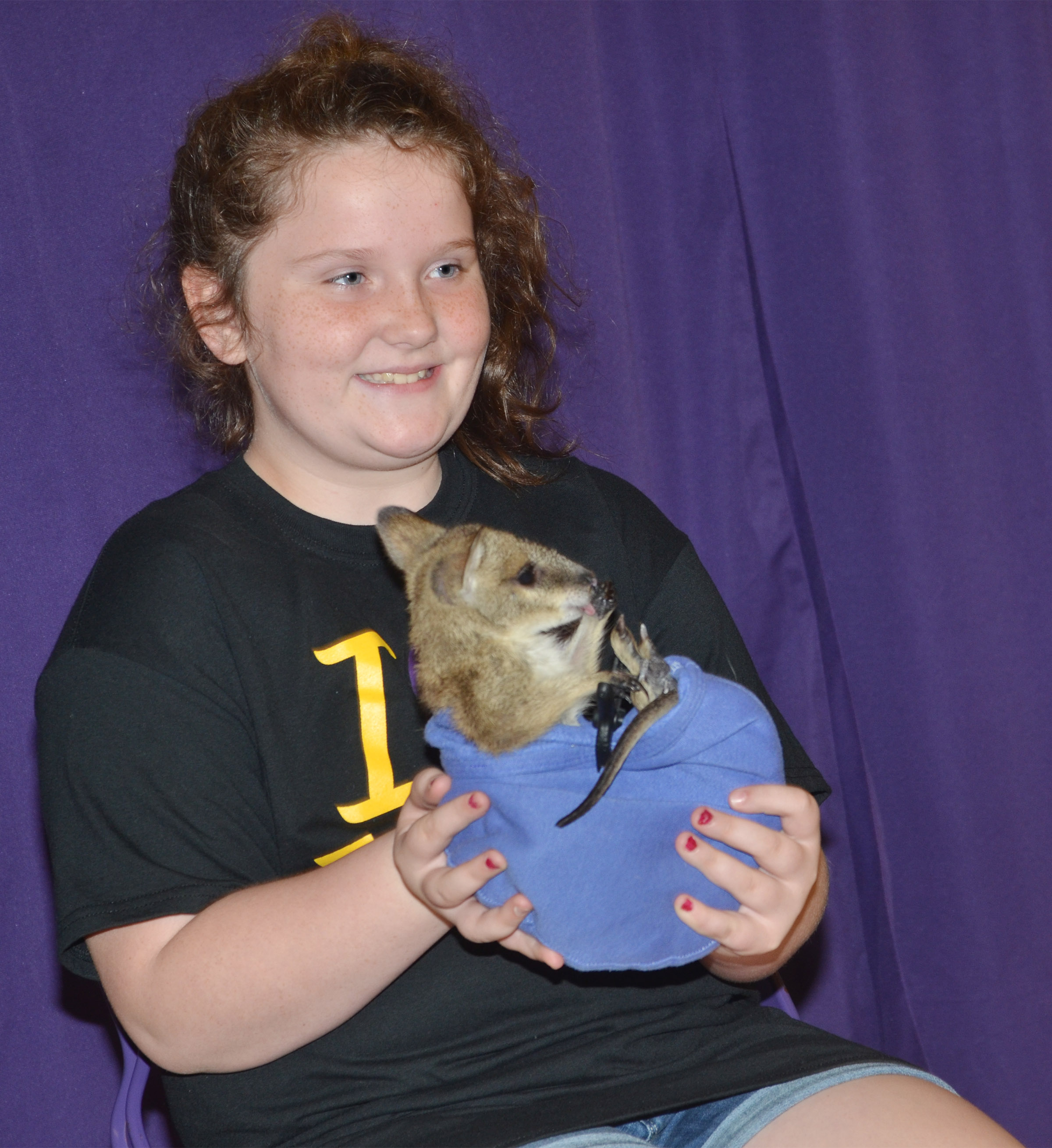 CES third-grader Madison Philpott holds Wendy the baby kangaroo.