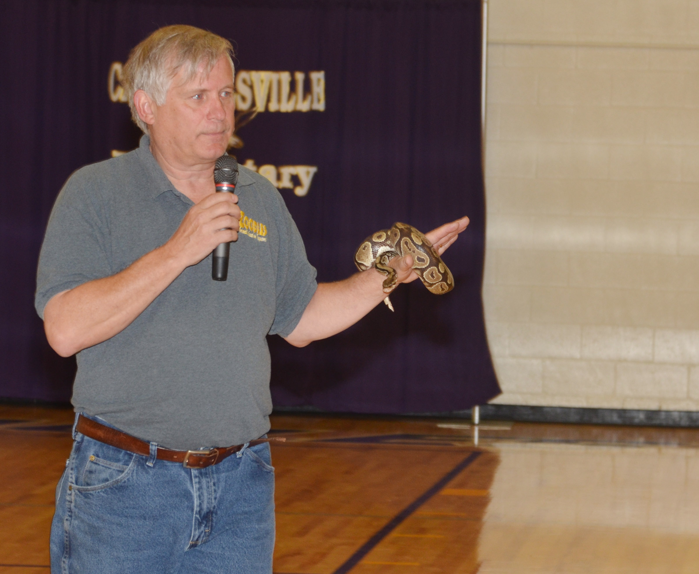 Steven Thomas of Zoodles animal education program shows CES students a python snake named Barbara.