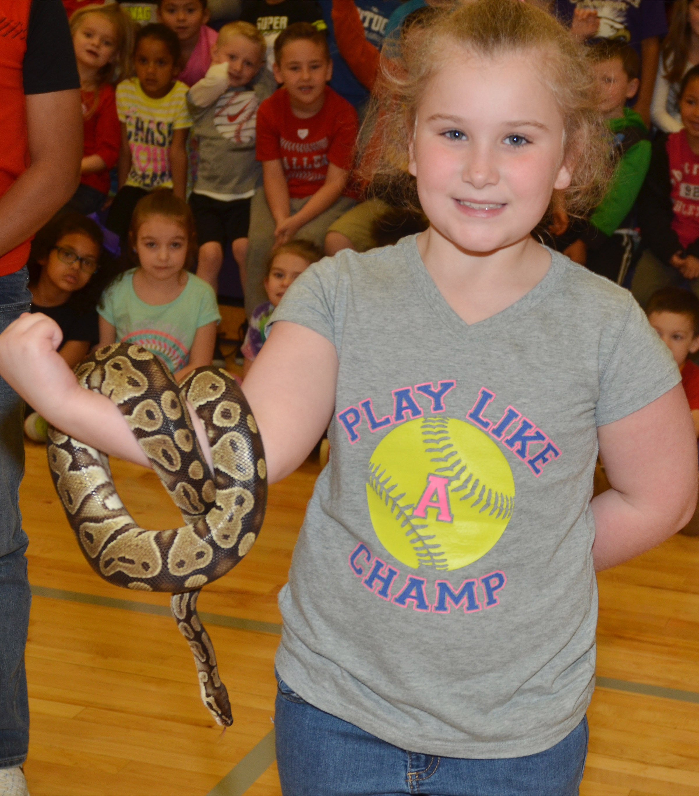 CES third-grader Kiera Bailey holds a python snake named Barbara.
