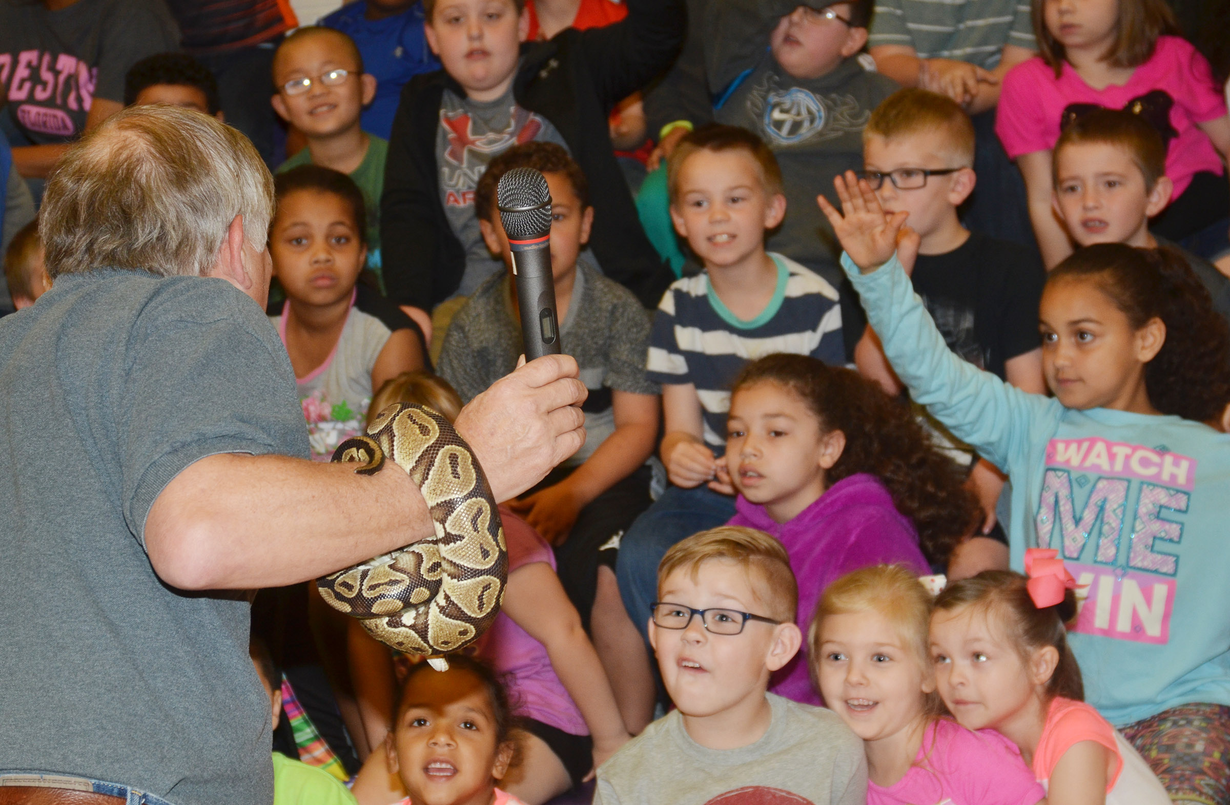 CES students react at Steven Thomas of Zoodles animal education program brings Barbara the python close to them.