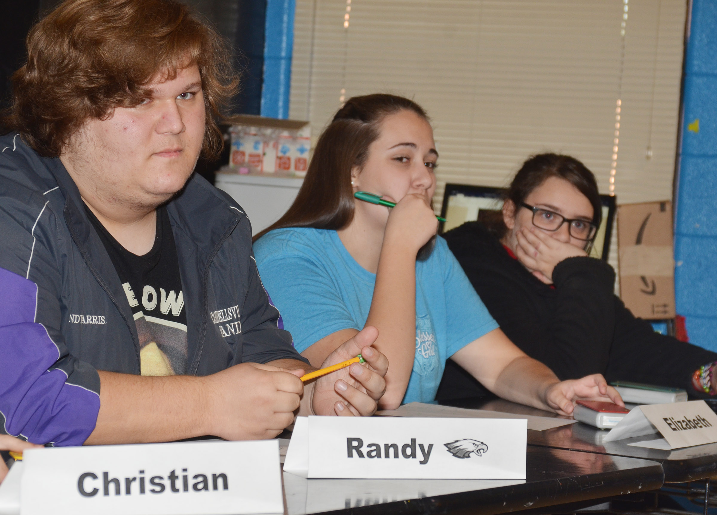 CHS academic team members, from left, juniors Randy Harris and Elizabeth Sullivan and freshman Haley Lopez listen to a question.