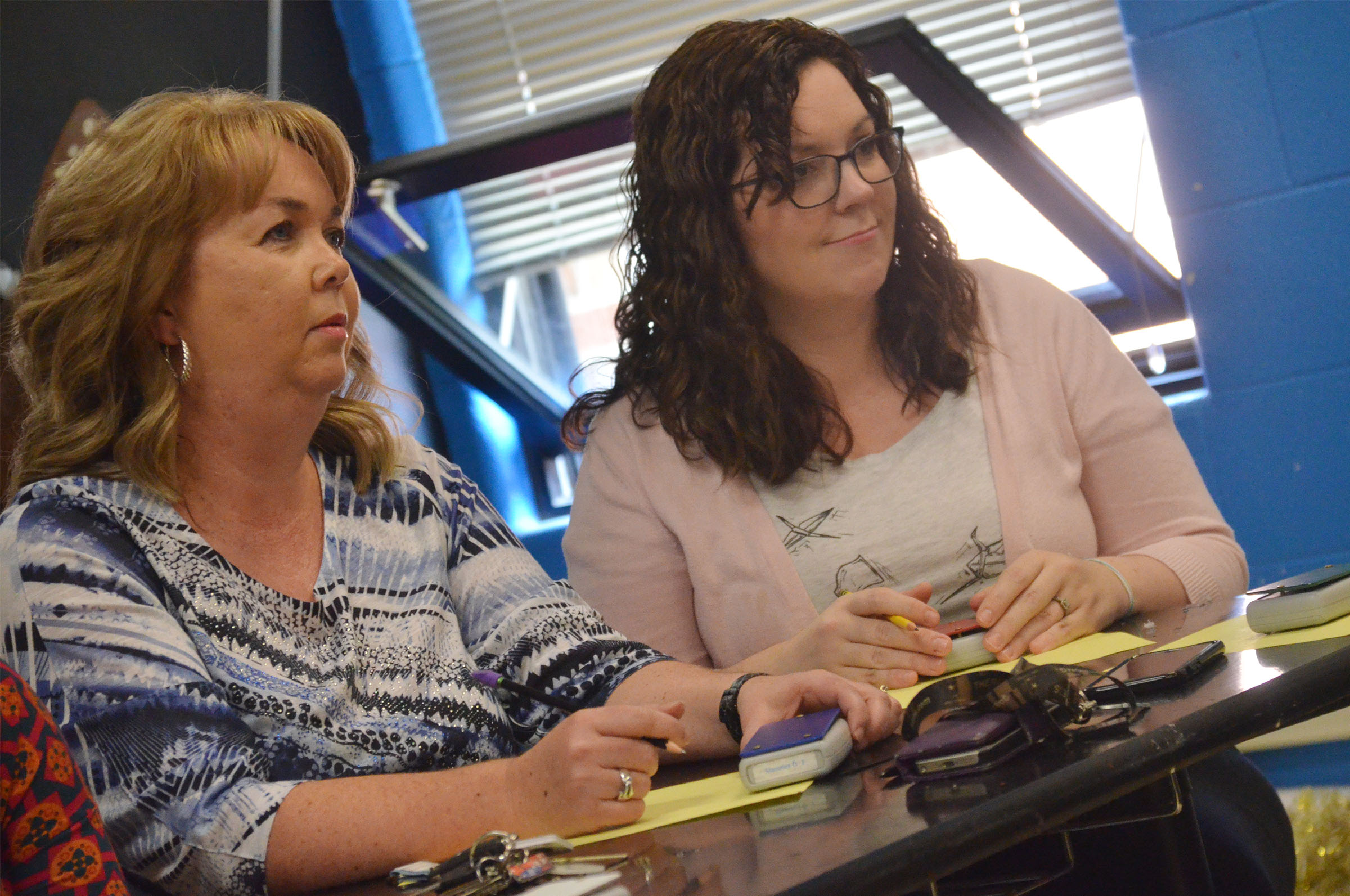 CHS teachers Sonya Kessler, at left, and Lindsay Williams listen to a question.