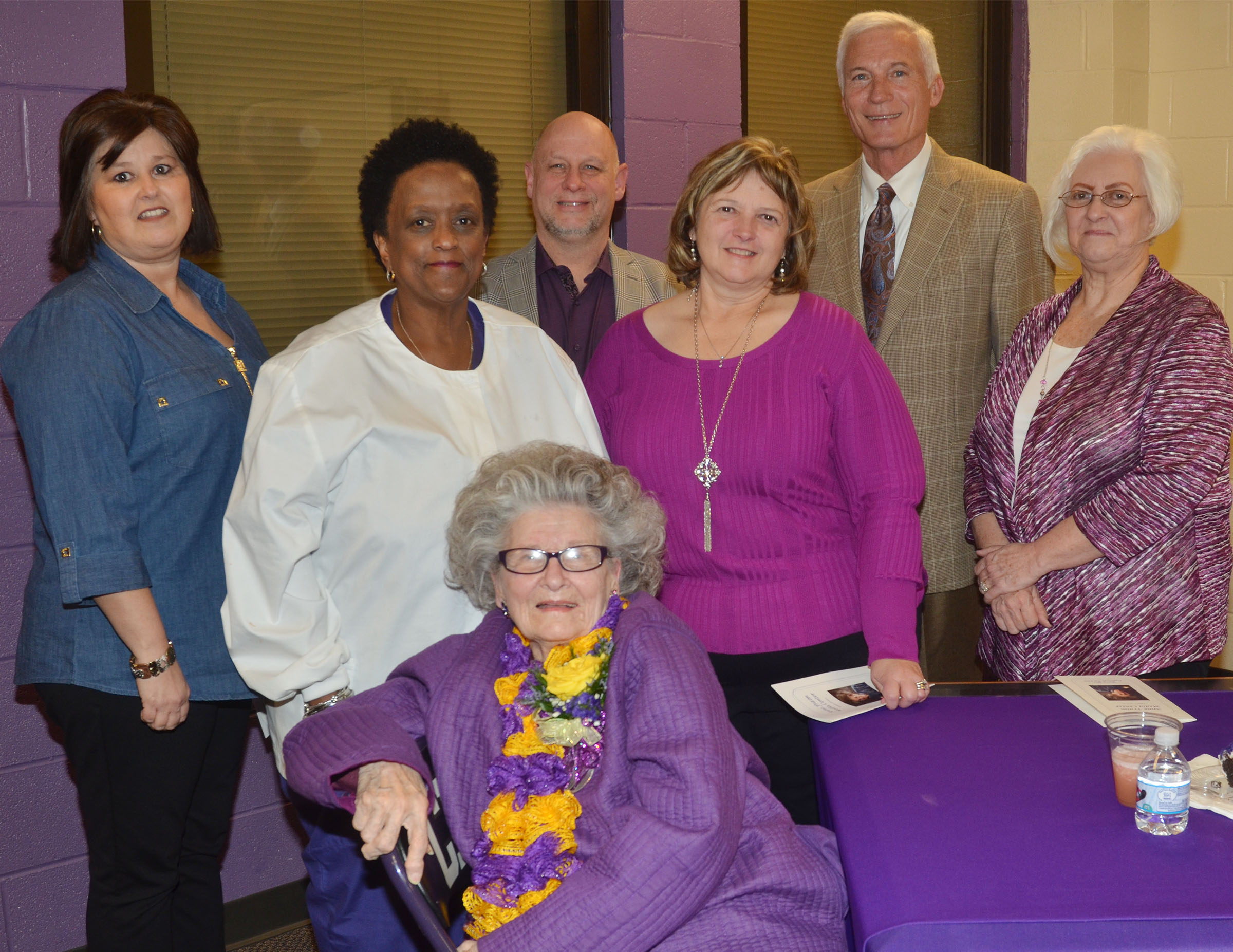 Former CHS employee Anne Fraim takes a photo with Campbellsville Board of Education members at the dedication of the Anne Fraim Media Center. From left, back, are Board members Suzanne Wilson and Barkley Taylor, Vice Chair Mitch Overstreet, Board member Angie Johnson, Superintendent Mike Deaton and Board Chair Pat Hall.