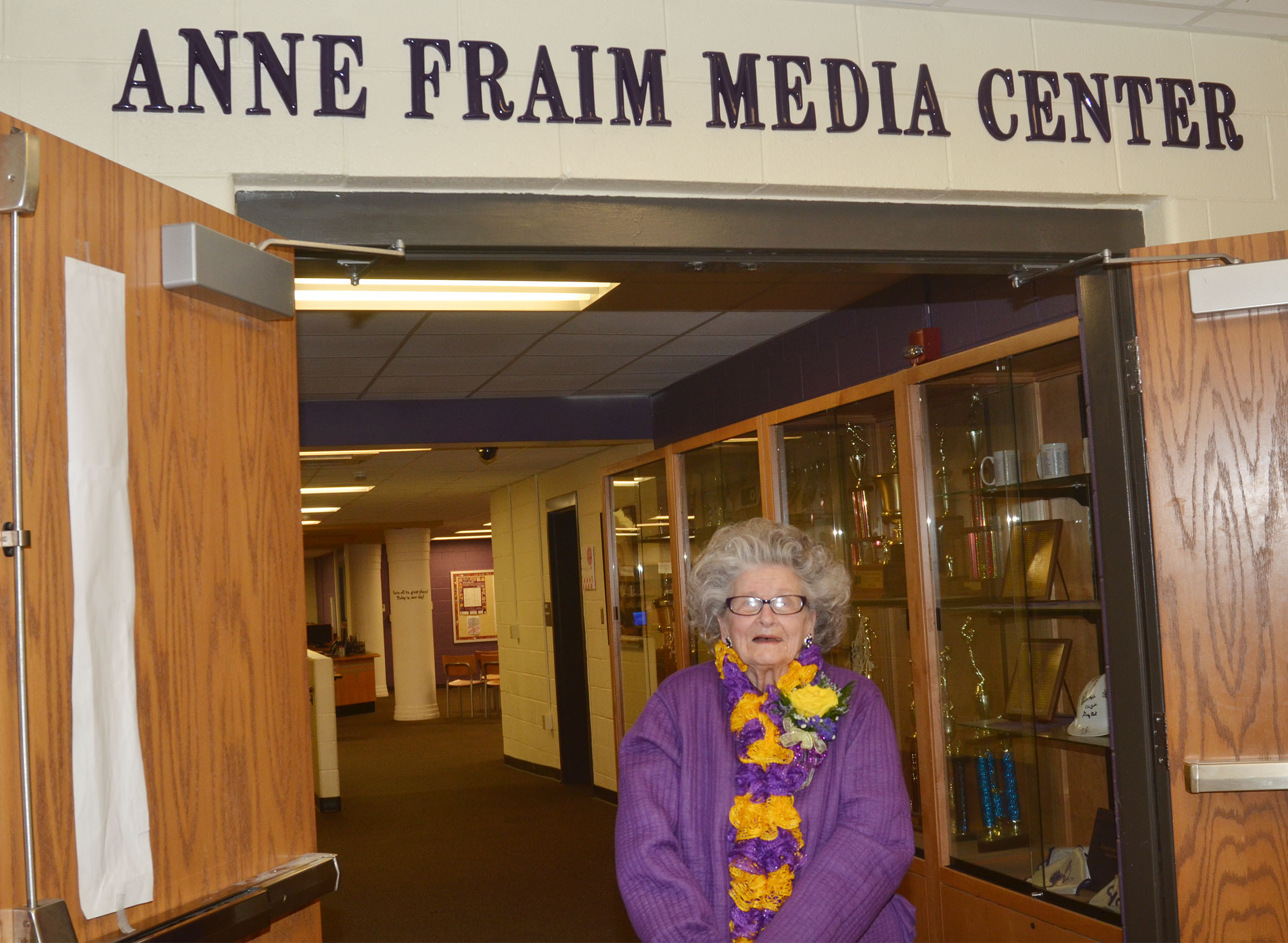 Former CHS employee Anne Fraim poses for a photo outside the newly dedicated Anne Fraim Media Center.
