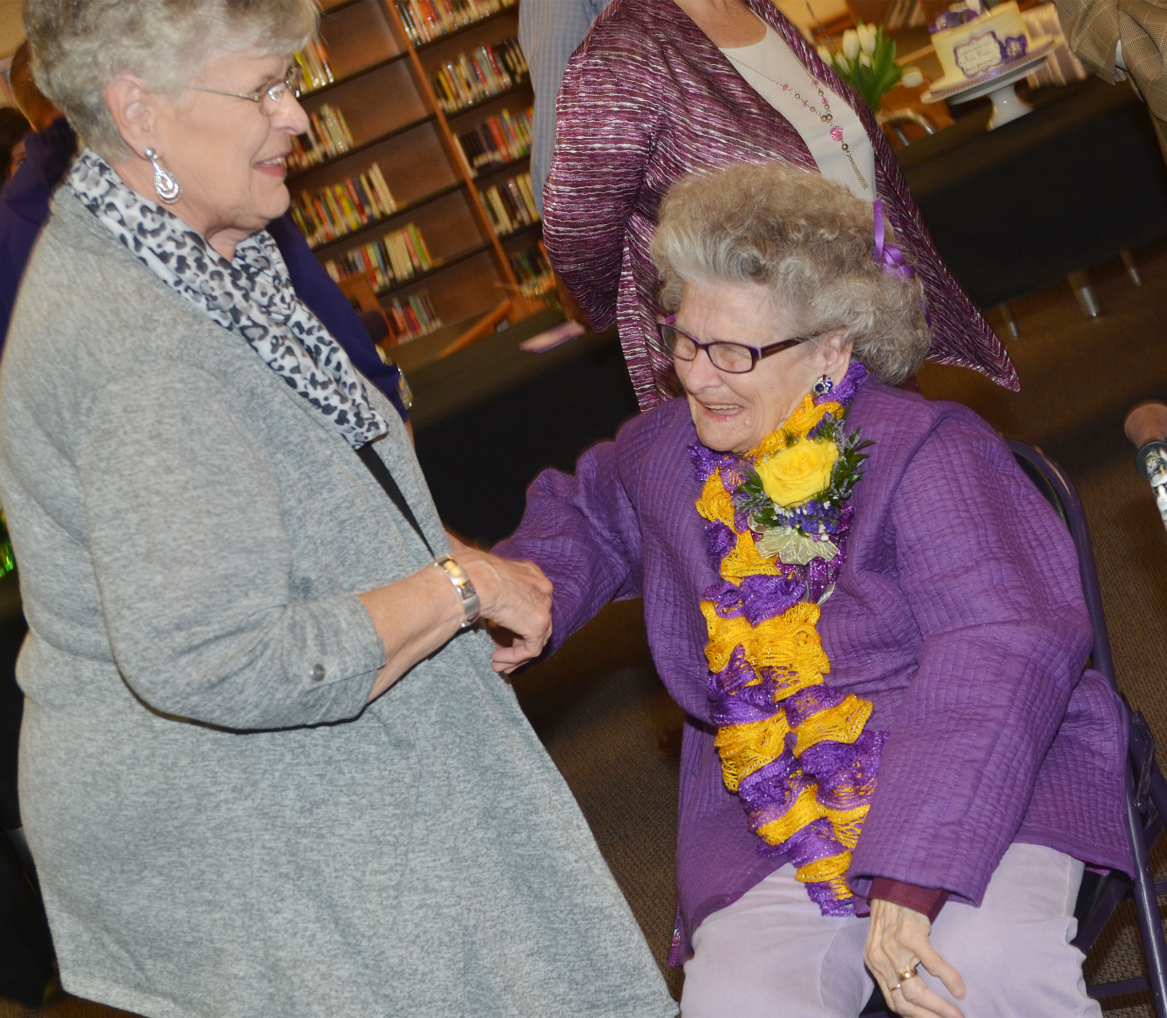 Former CHS employee Anne Fraim shares a laugh with former co-worker Margaret Pyles.