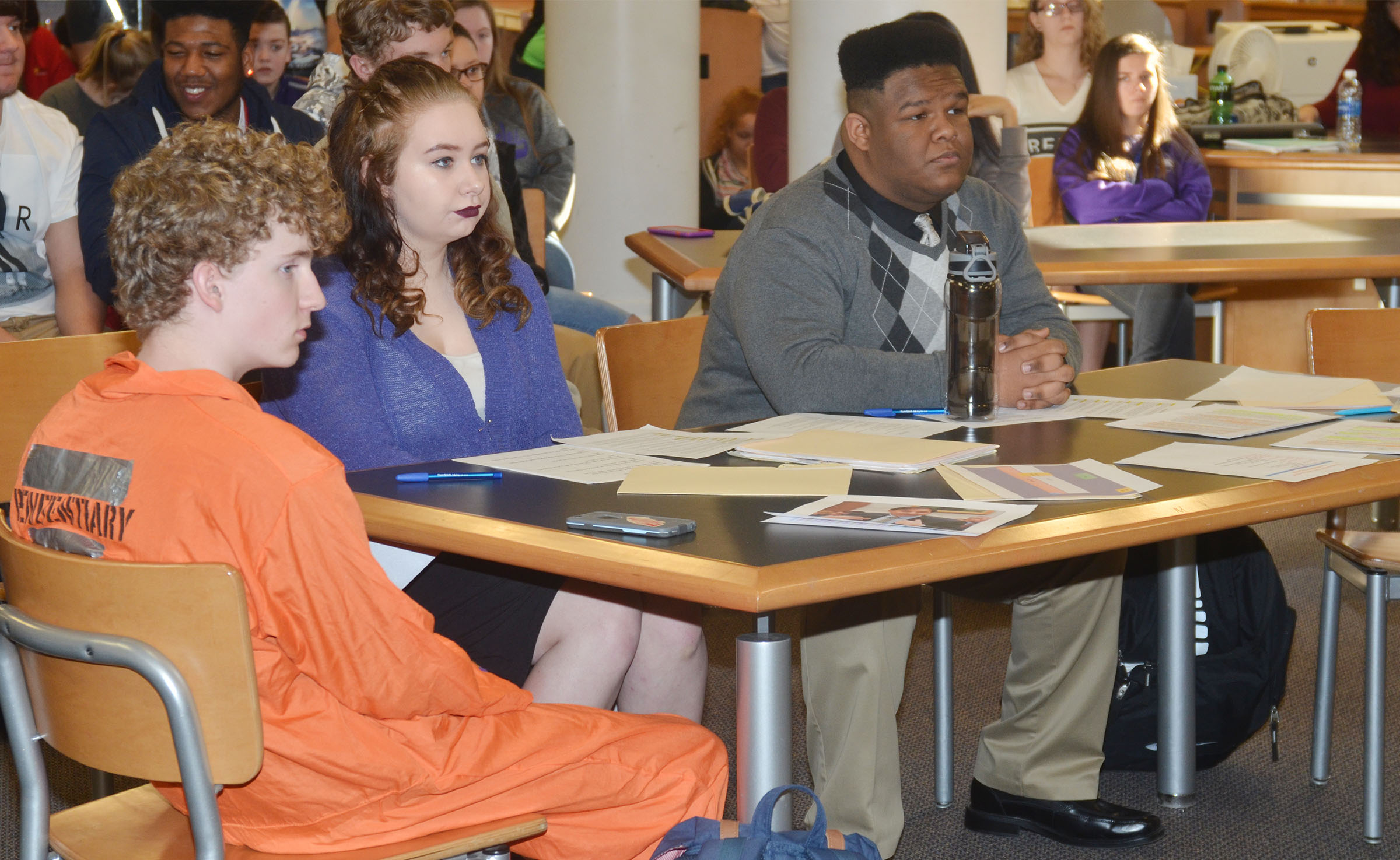 CHS sophomore Jackson Hinton, at left, was on trial for murdering his fiance. At right are his defense attorneys, sophomores Leslie McKenzie and Jeremiah Jackson.